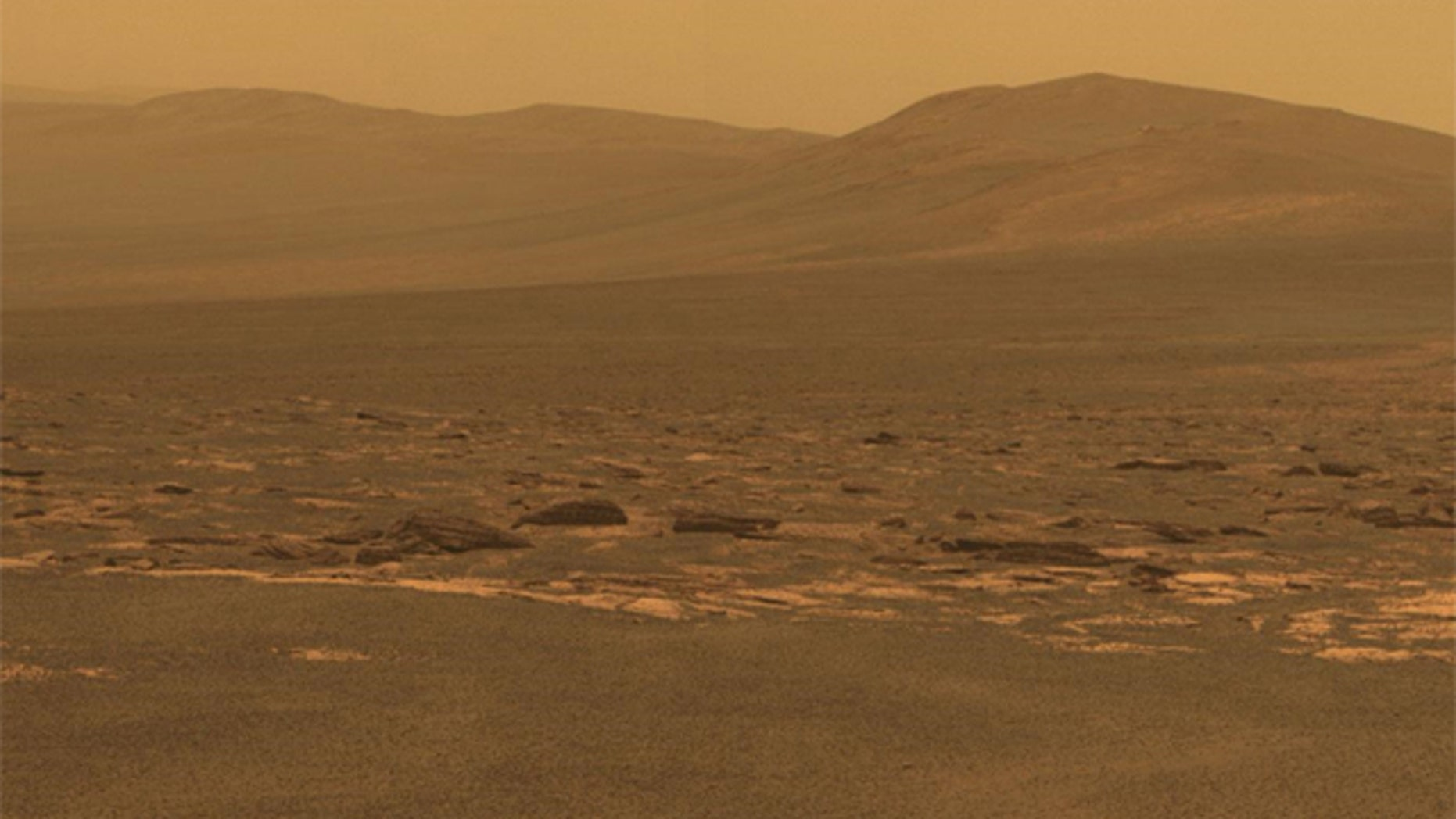 A portion of the west rim of Endeavour crater sweeps southward in this color view from NASA's Mars Exploration Rover Opportunity.