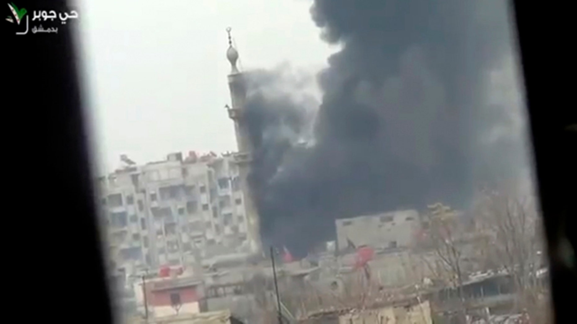 Feb. 6, 2013: This image taken from video obtained from Ugarit News, which has been authenticated based on its contents and other AP reporting, shows smoke and fire billowing from an explosion in Damascus, Syria.