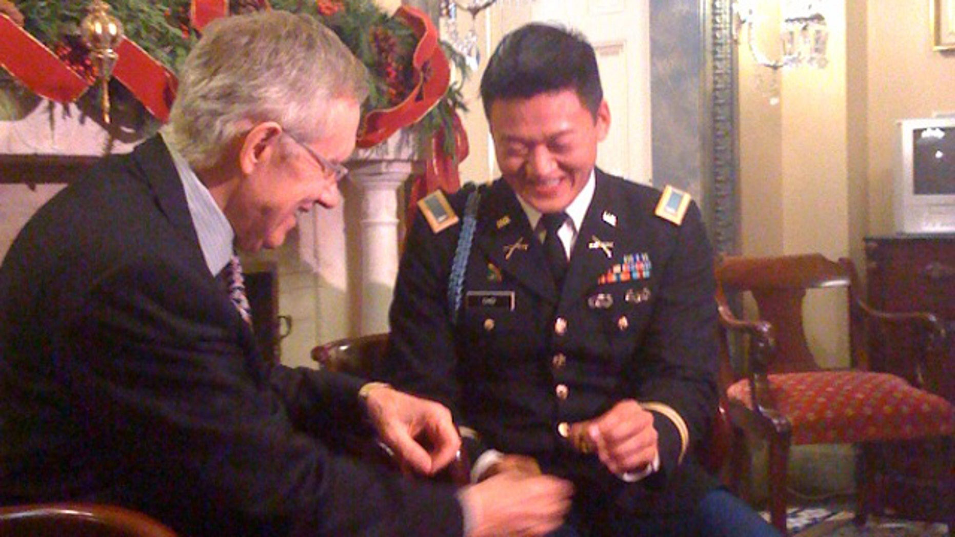 Wednesday: Senate Majority Leader Harry Reid hands gay rights activist Lt. Dan Choi his West Point graduation ring after President Obama signed the repeal of don't ask, don't tell.