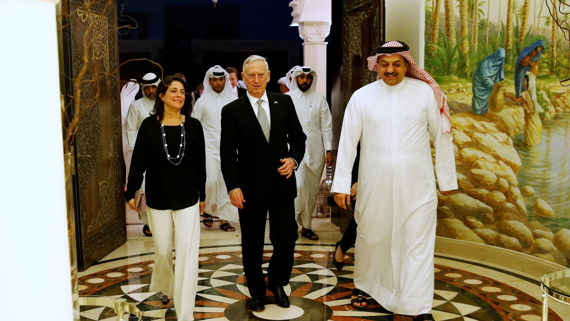 Qatar's Minister of Defence Khalid bin Mohammad Al-Attiyah (R) welcomes U.S. Defence Secretary James Mattis (C) and U.S. Ambassador to Qatar Dana Shell Smith (L) at his residence in Doha, Qatar April 22, 2017. REUTERS/Jonathan Ernst - RTS13GRB