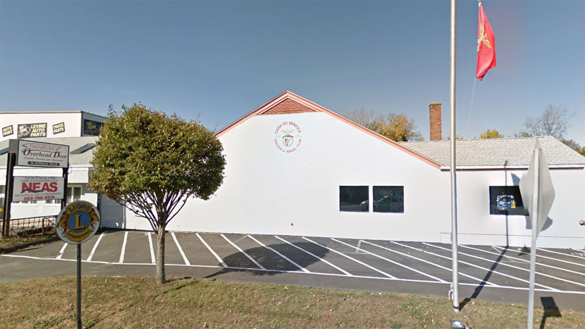 The man reportedly fell from the roof of the Danbury social club and onto a rotisserie stand.