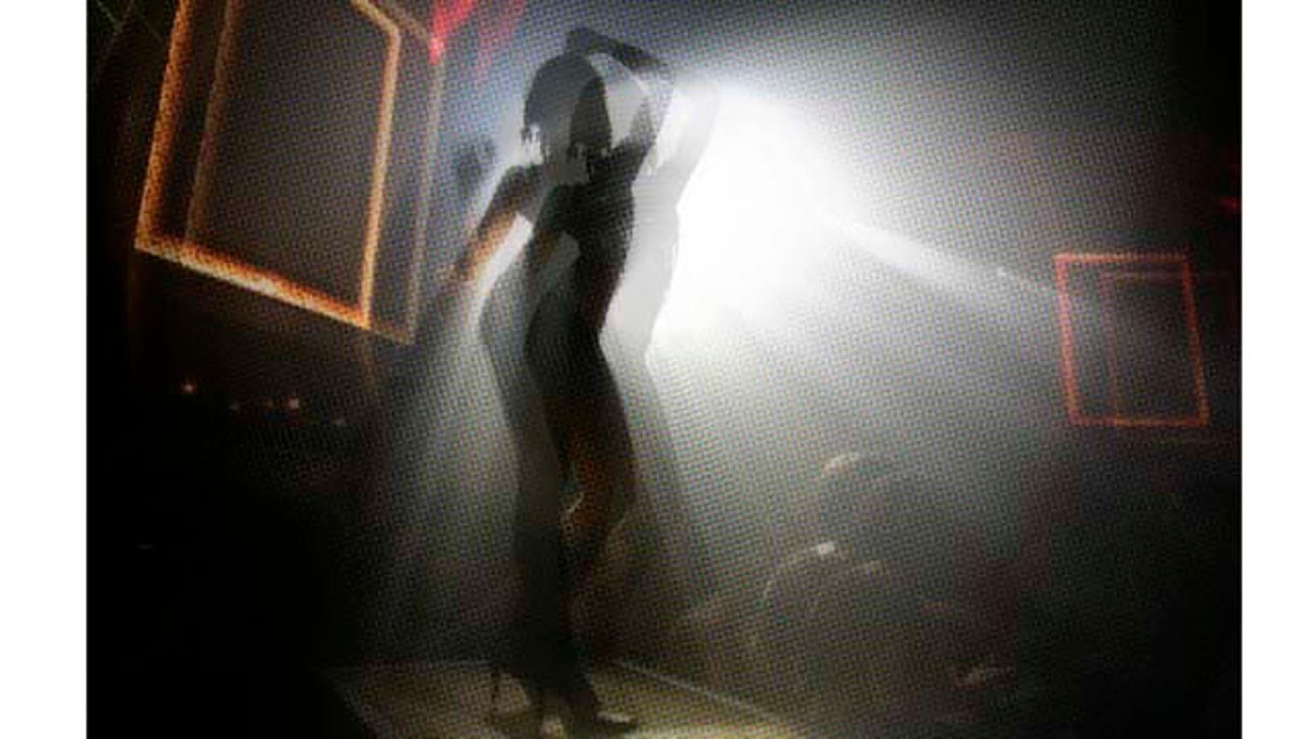 ** FOR IMMEDIATE RELEASE **A girl dances on a platform at the Mansion nightclub in Miami Beach, Fla., Nov. 10, 2006. (AP Photo/Lynne Sladky)