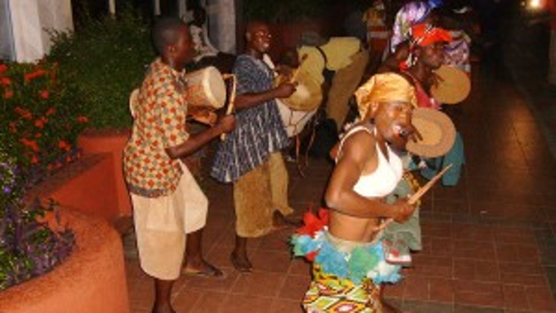 Ghanian dance troupe welcome the White House press corps (Photo by Major Garrett)
