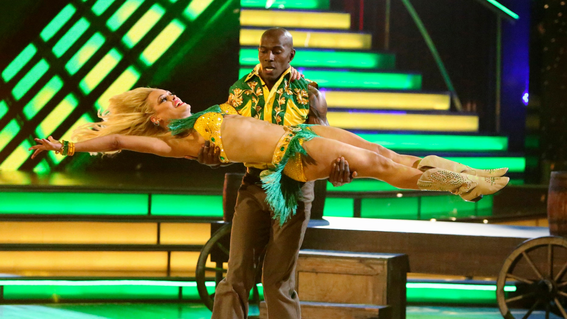 """May 21, 2012: Donald Driver and his partner Peta Murgatroyd perform on the celebrity dance competition series """"Dancing with the Stars"""" in Los Angeles. Driver won the mirror ball trophy Tuesday. (AP Photo/ABC, Adam Taylor)"""