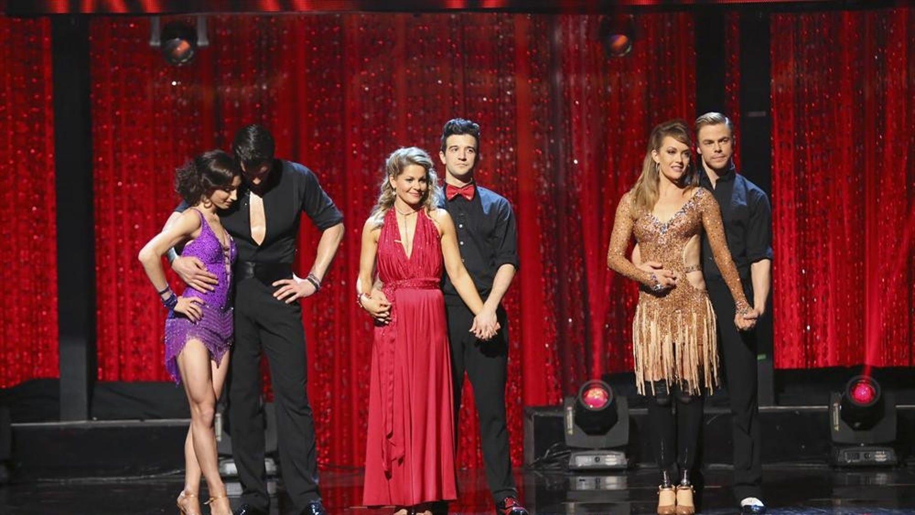 "Meryl Davis, Maksim Chmerkovskiy, Cancace Cameron Bure, Mark Ballas, Am Purdy and Derek Hough in the finals of ""Dancing with the Stars."""