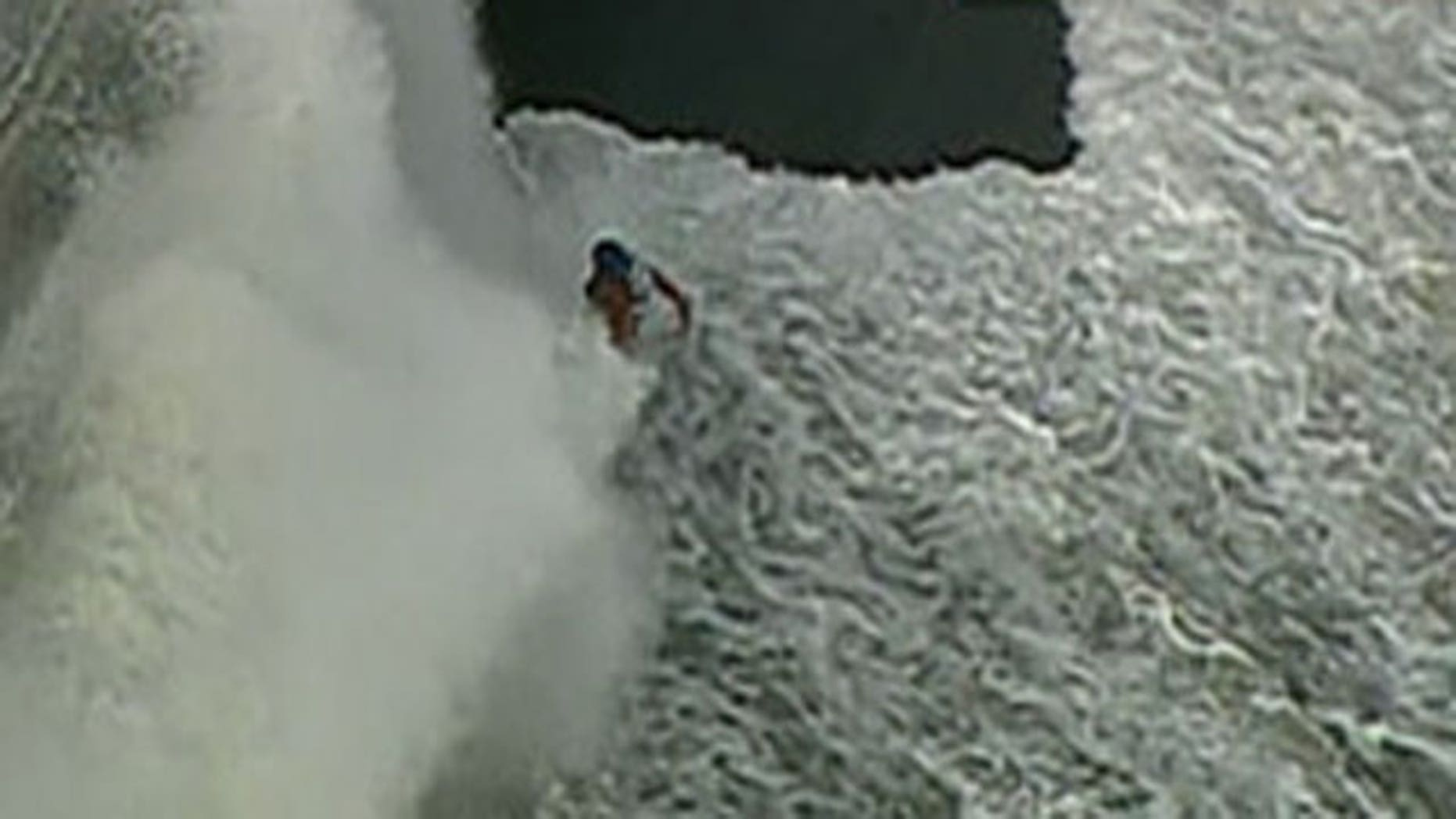 Sept. 30, 2011: A cyclist is hit by a wave while traveling along the Lake Michigan jogging path.
