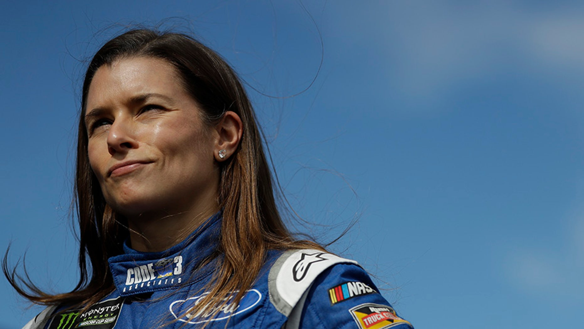 Danica Patrick stands near the garage area after practice for Sunday's NASCAR Cup series auto race, Saturday, July 29, 2017, in Long Pond, Pa. (AP Photo/Matt Slocum)