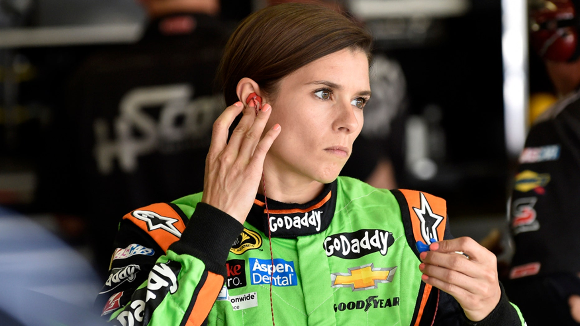 NASCAR driver Danica Patrick gets ready to practice for Sunday's NASCAR auto race at Atlanta Motor Speedway in Hampton, Ga., Friday, Aug. 29, 2014. (AP Photo/David Tulis)