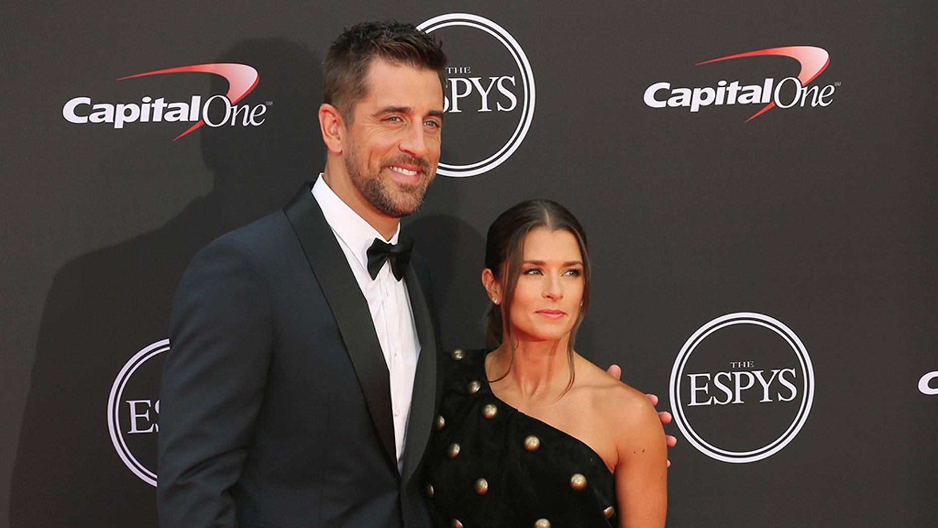 Danica Patrick and Aaron Rodgers made their red carpet debut at the 2018 ESPY Awards in July.