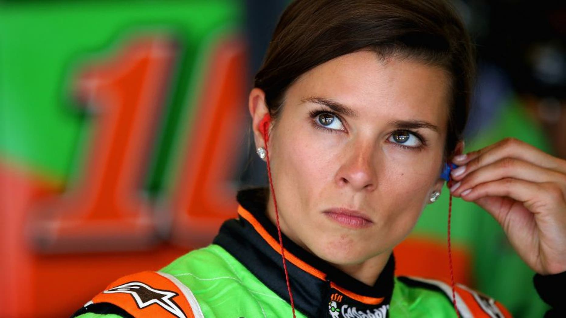 INDIANAPOLIS, IN - JULY 24: Danica Patrick, driver of the #10 GoDaddy Chevrolet, stands in the garage during practice for the NASCAR Sprint Cup Series Crown Royal Presents the Jeff Kyle 400 at the Brickyard at Indianapolis Motorspeedway on July 24, 2015 in Indianapolis, Indiana. (Photo by Sean Gardner/NASCAR via Getty Images)