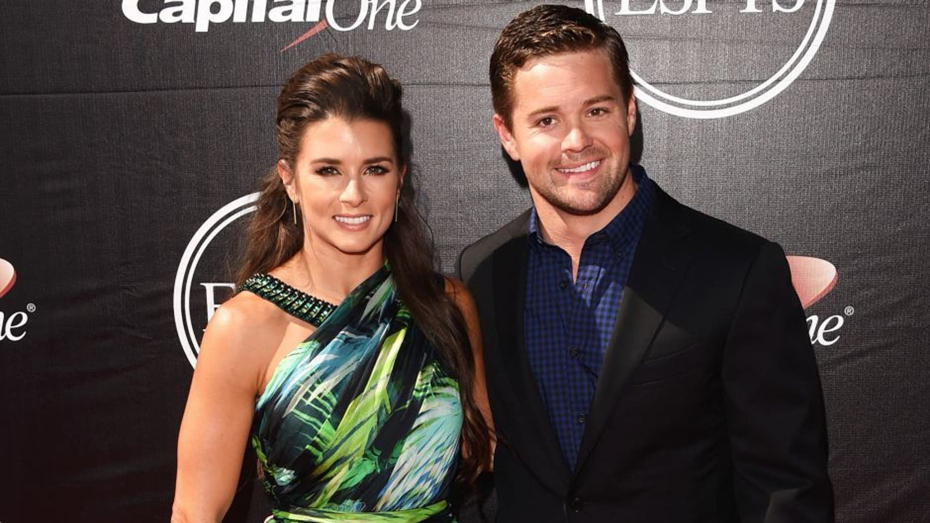 LOS ANGELES, CA - JULY 15: (L-R) Driver Danica Patrick with driver Ricky Stenhouse, Jr. attends The 2015 ESPYS at Microsoft Theater on July 15, 2015 in Los Angeles, California. (Photo by Jason Merritt/Getty Images)