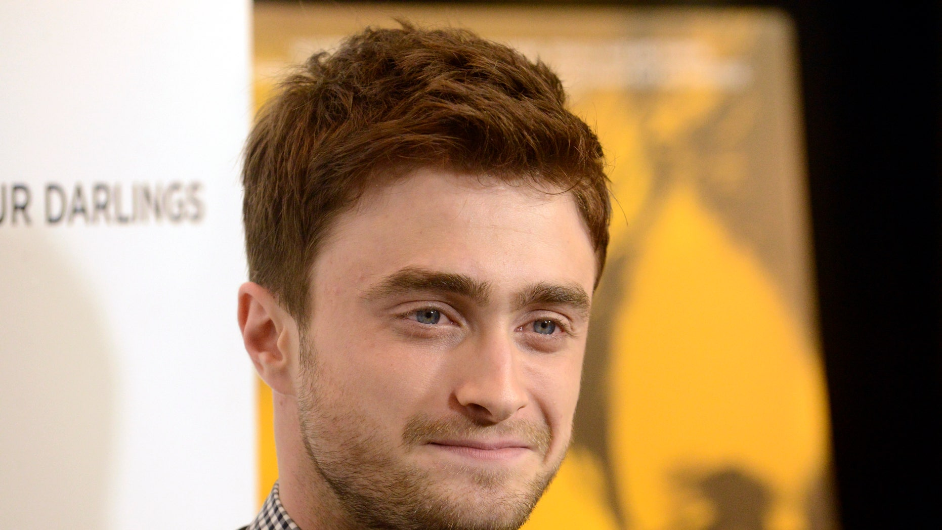 """Cast member Daniel Radcliffe attends the film premiere of """"Kill Your Darlings"""" in Beverly Hills, California October 3, 2013."""