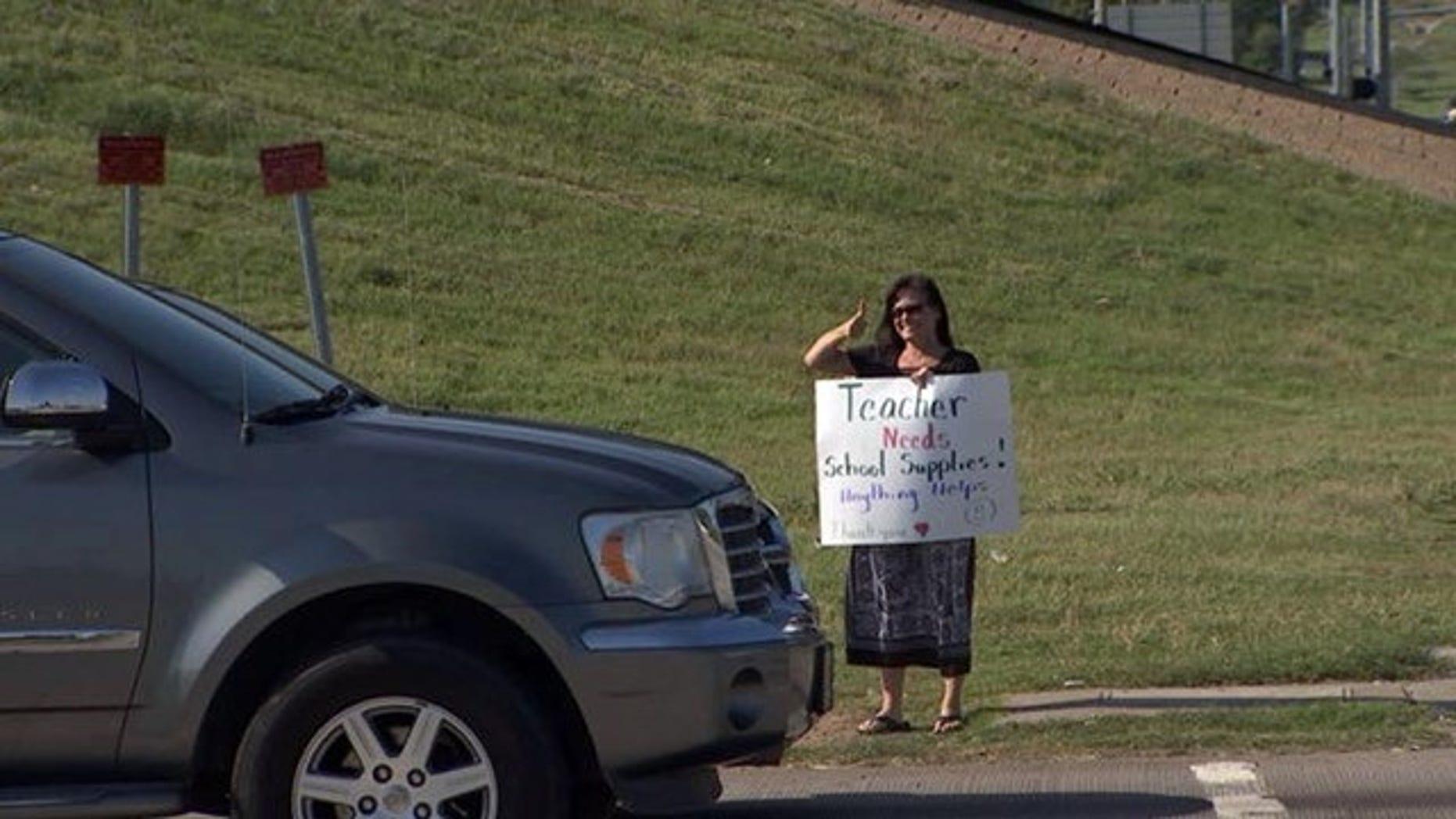 Tulsa, Okla., third-grade teacher Teresa Danks took to panhandling in order to raise money to buy classroom supplies.