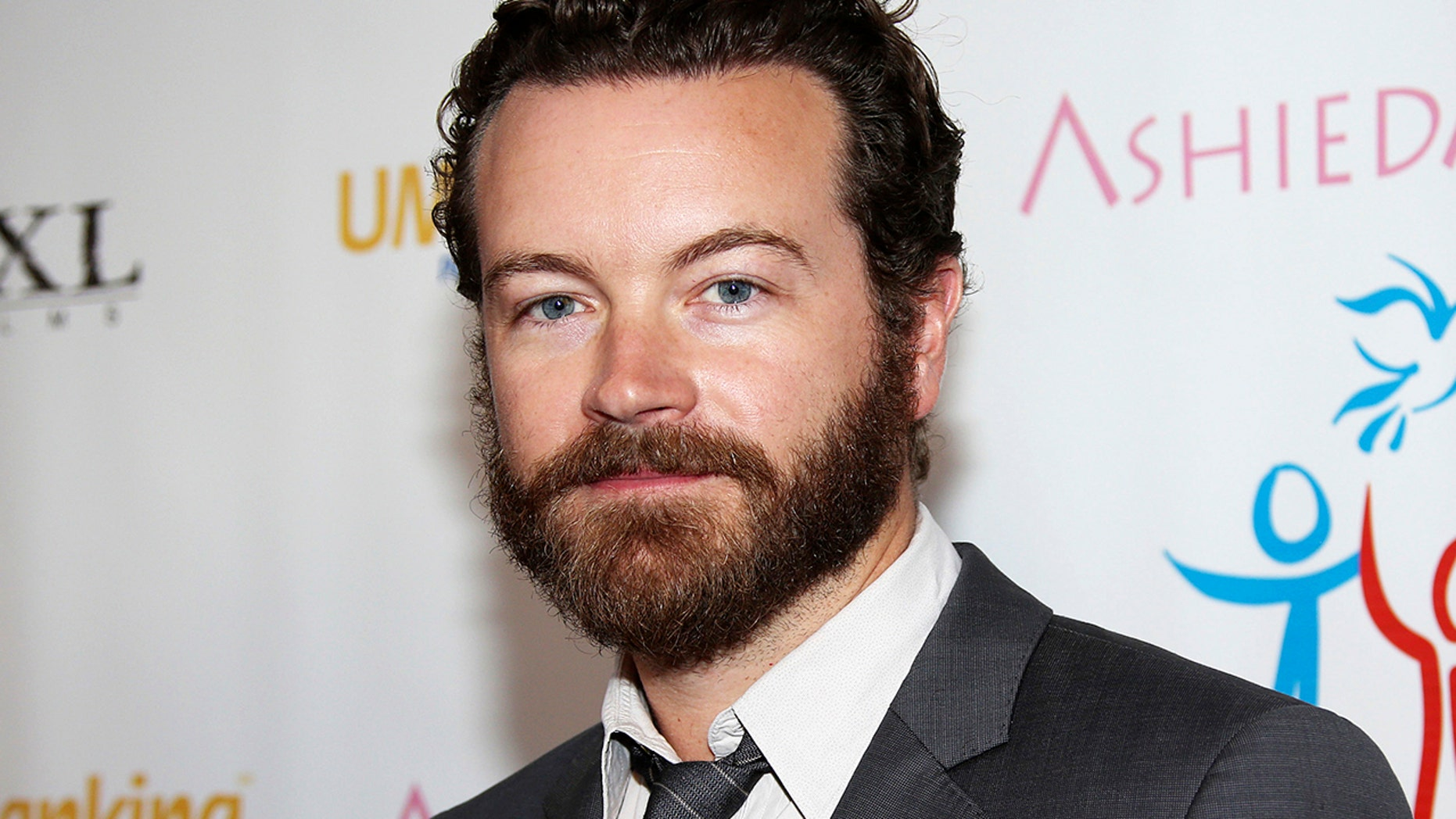 In this March 24, 2014 file photo, actor Danny Masterson arrives at the Youth for Human Rights International Celebrity Benefit in Los Angeles.