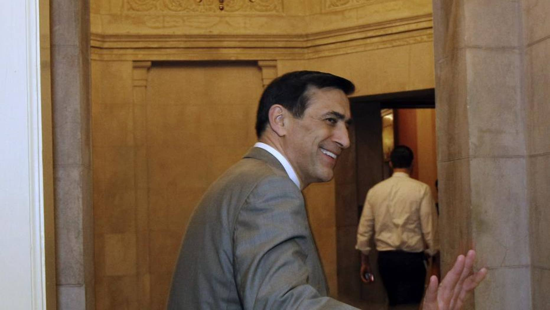Rep. Darrell Issa, R-Calif., goes into Speaker John Boehner's office on Capitol Hill Friday, April 8, 2011 in Washington.(AP Photo/Alex Brandon)