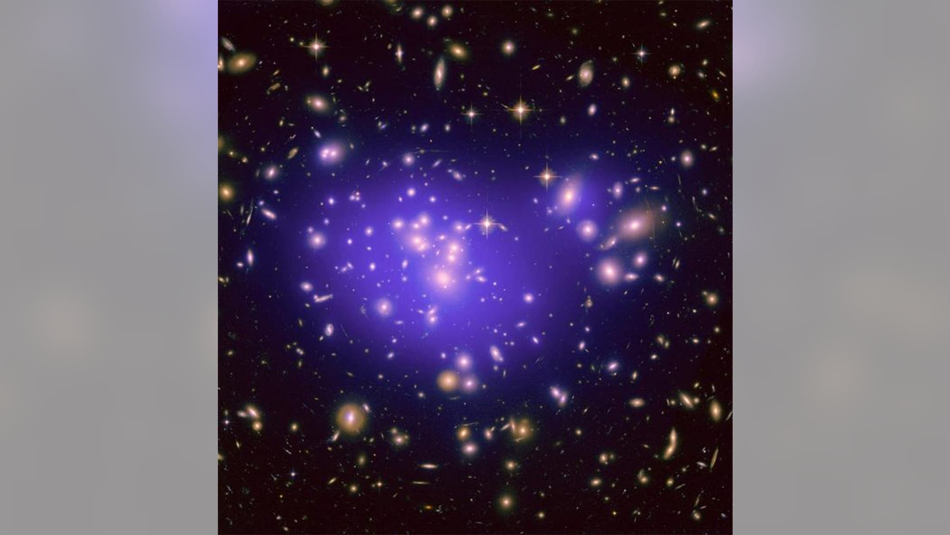 """The galaxy cluster Abell 1689 is famous for the way it bends light in a phenomenon called gravitational lensing. A new study of the cluster is revealing secrets about how dark energy shapes the universe. <a href=""""http://www.space.com/scienceastr&lt;/p"""">NASA, ESA, E. Jullo (JPL/LAM), P. Natarajan (Yale) and J-P. Kneib (LAM) </a>"""
