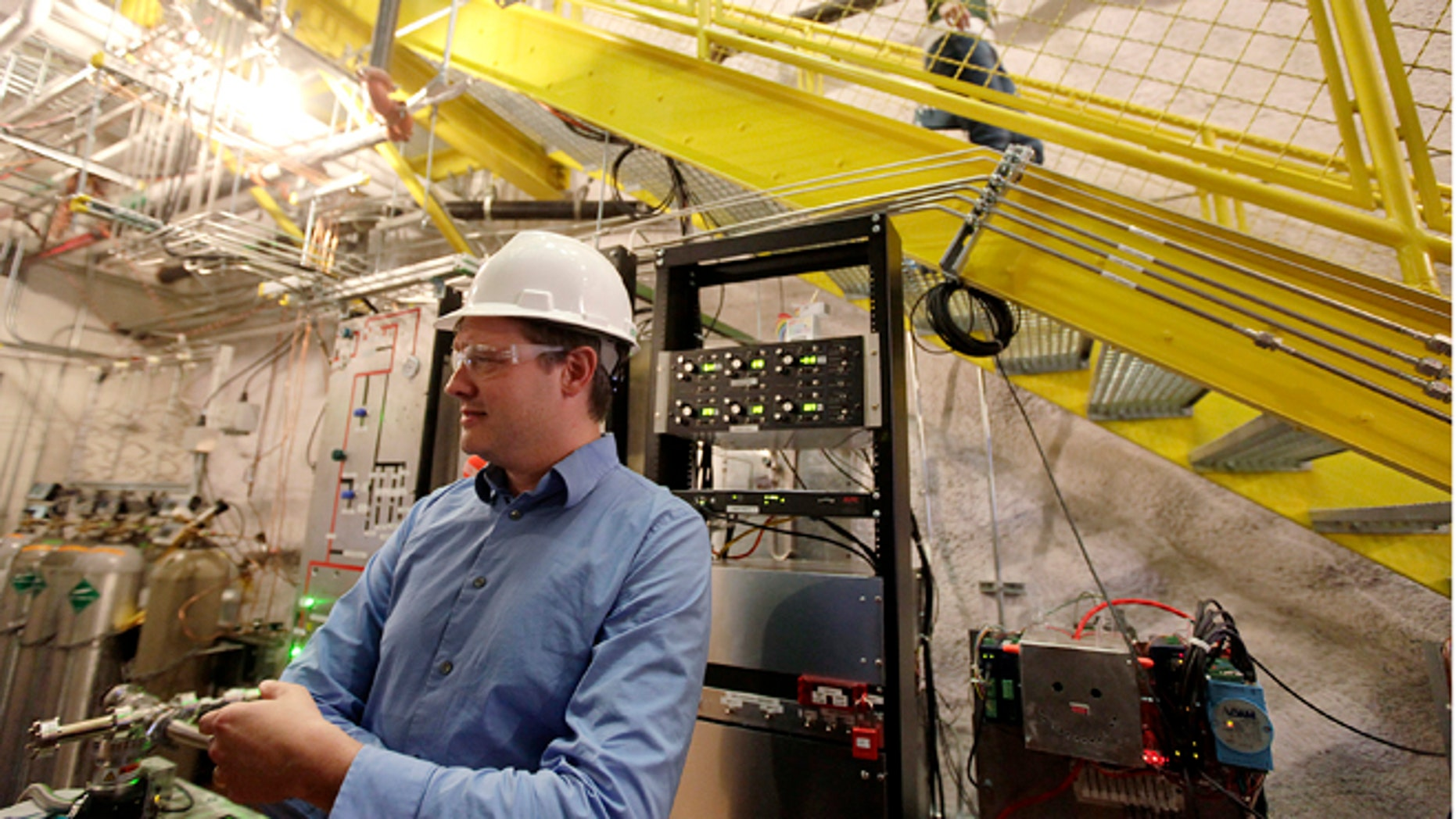 Oct. 29, 2013: Physicist Dan McKinsey, of Yale University, explains an experiment being conducted deep in an abandoned gold mine in Lead, S.D., to search for elusive and mysterious dark matter.