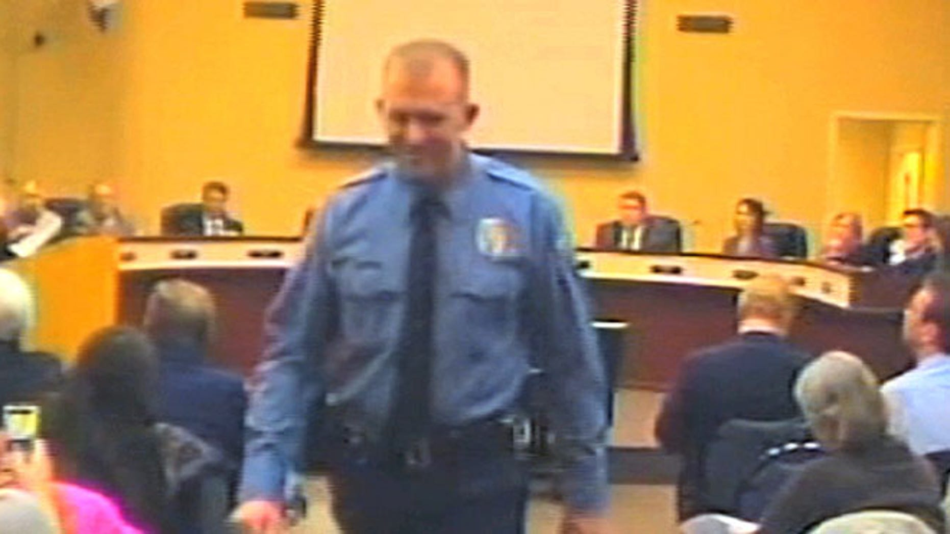 Feb. 11, 2014: Officer Darren Wilson attends a city council meeting in Ferguson
