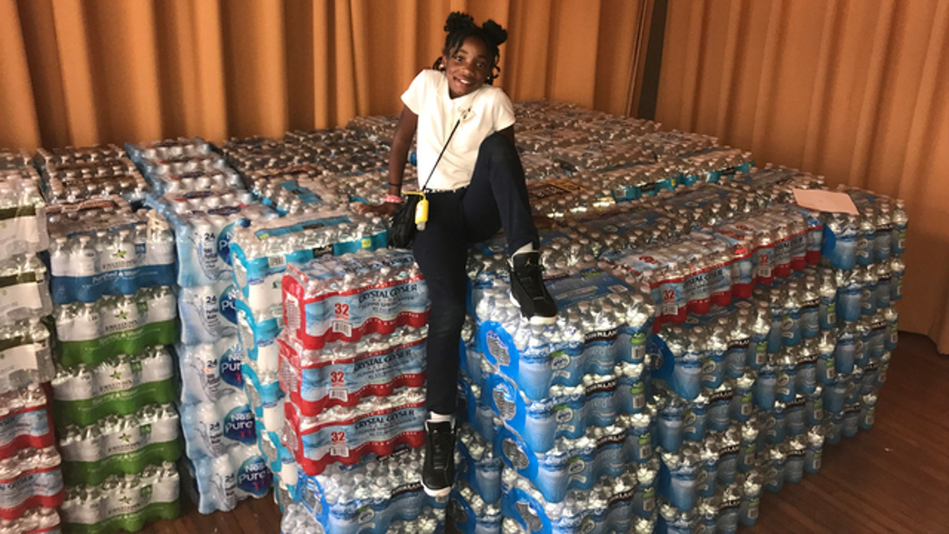Dashai Morton, 12, with her donations to hurricane victims in Puerto Rico.
