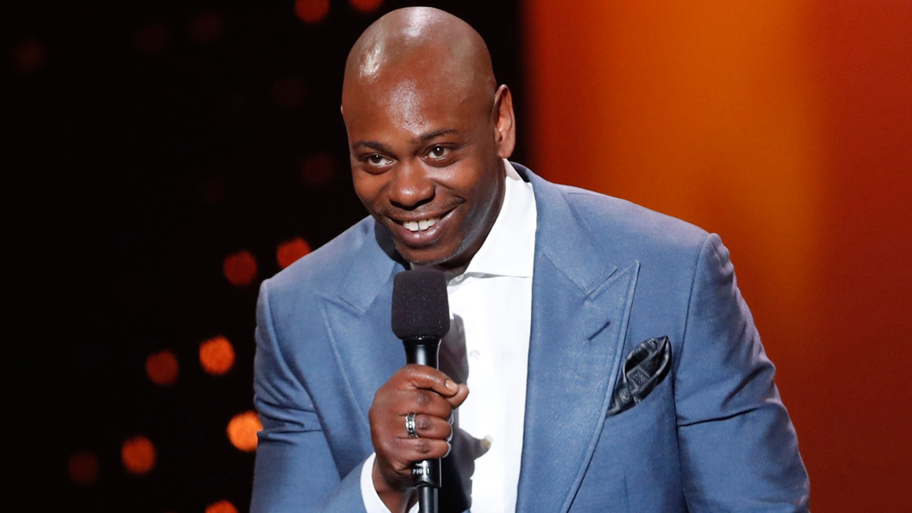 Dave Chappelle says he feels sorry for poor white Trump voters in new stand-up special on Netflix. Here, Chappelle presents an award at the 2017 Canadian Screen Awards in Toronto.