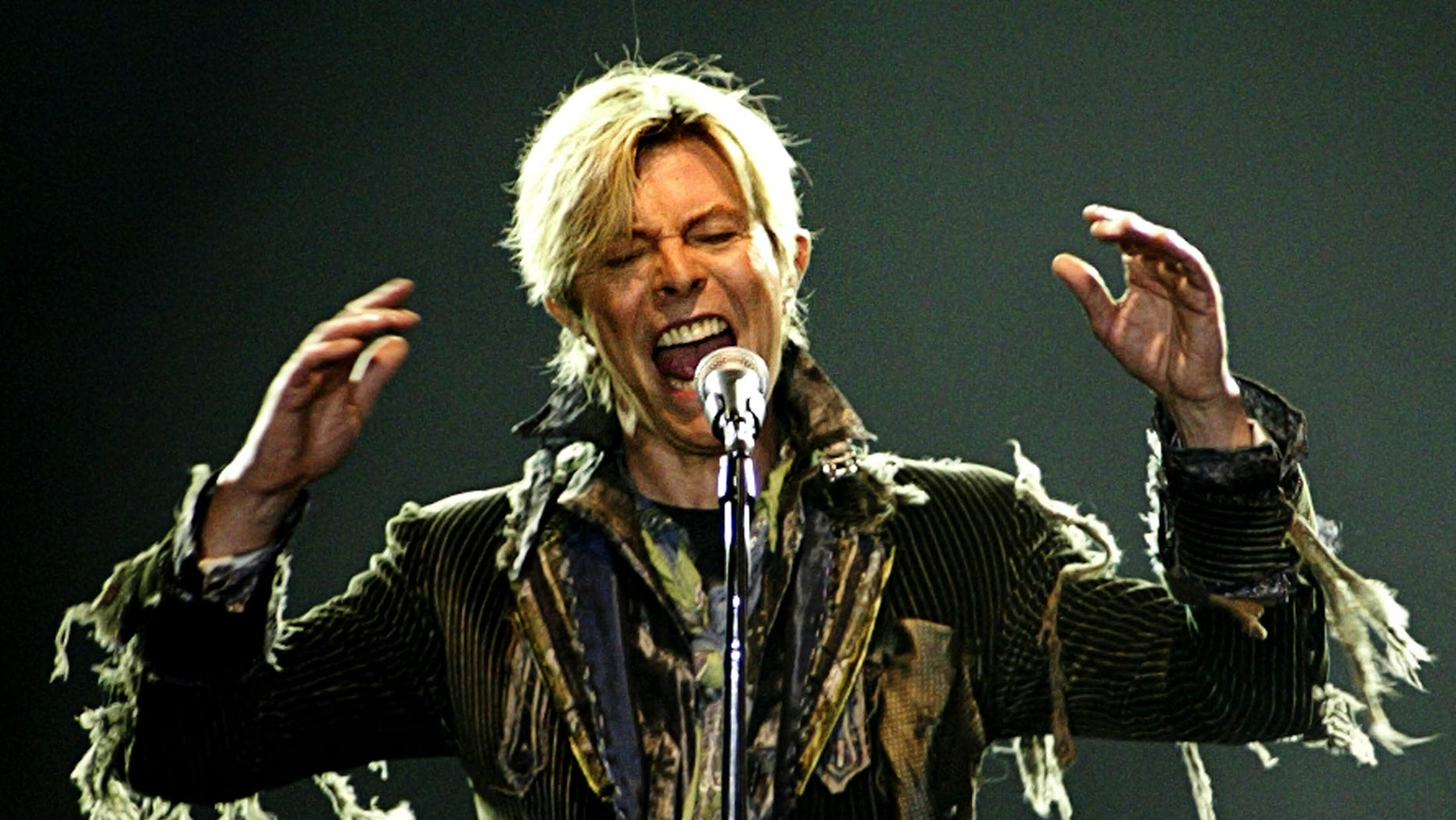 """June 23, 2004. British singer David Bowie performs in a concert during his worldwide tour called """"A Reality Tour"""" at T-mobile arena in Prague."""