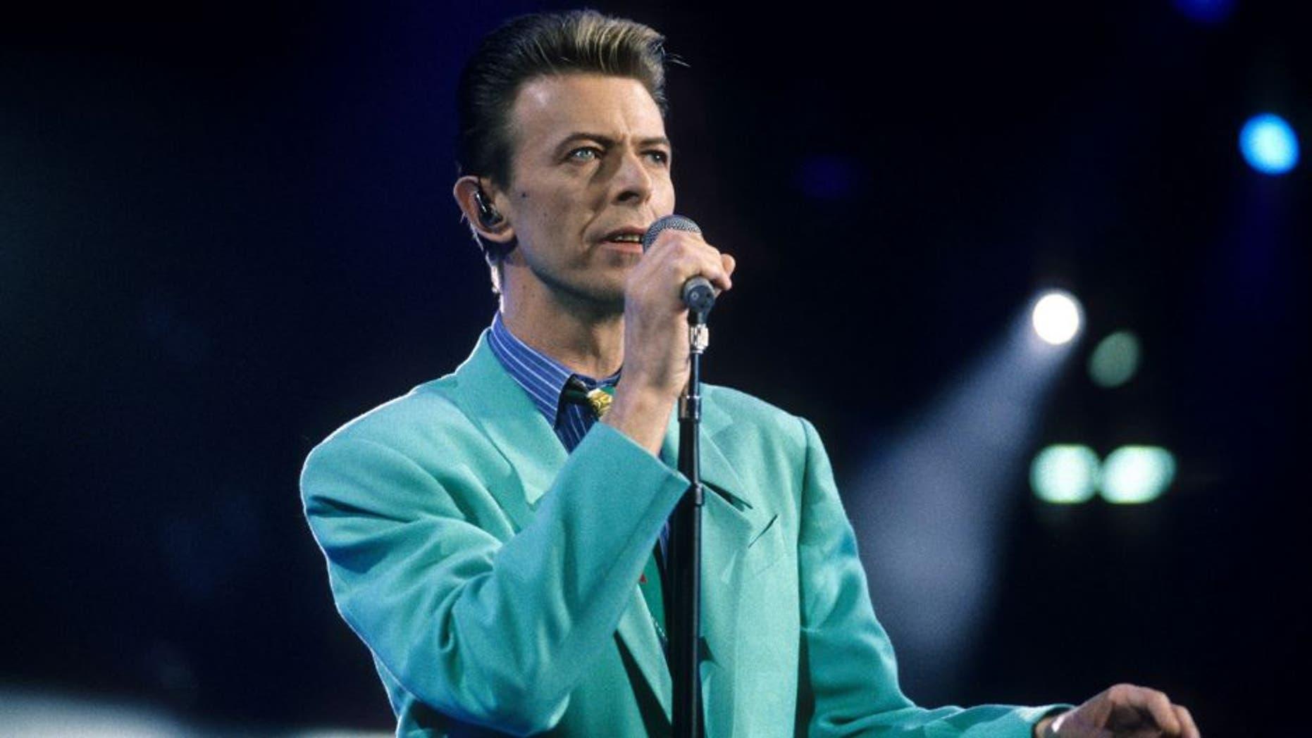 "David Bowie performs ""Under Pressure"" (Photo by Kevin Mazur Archive/WireImage)"