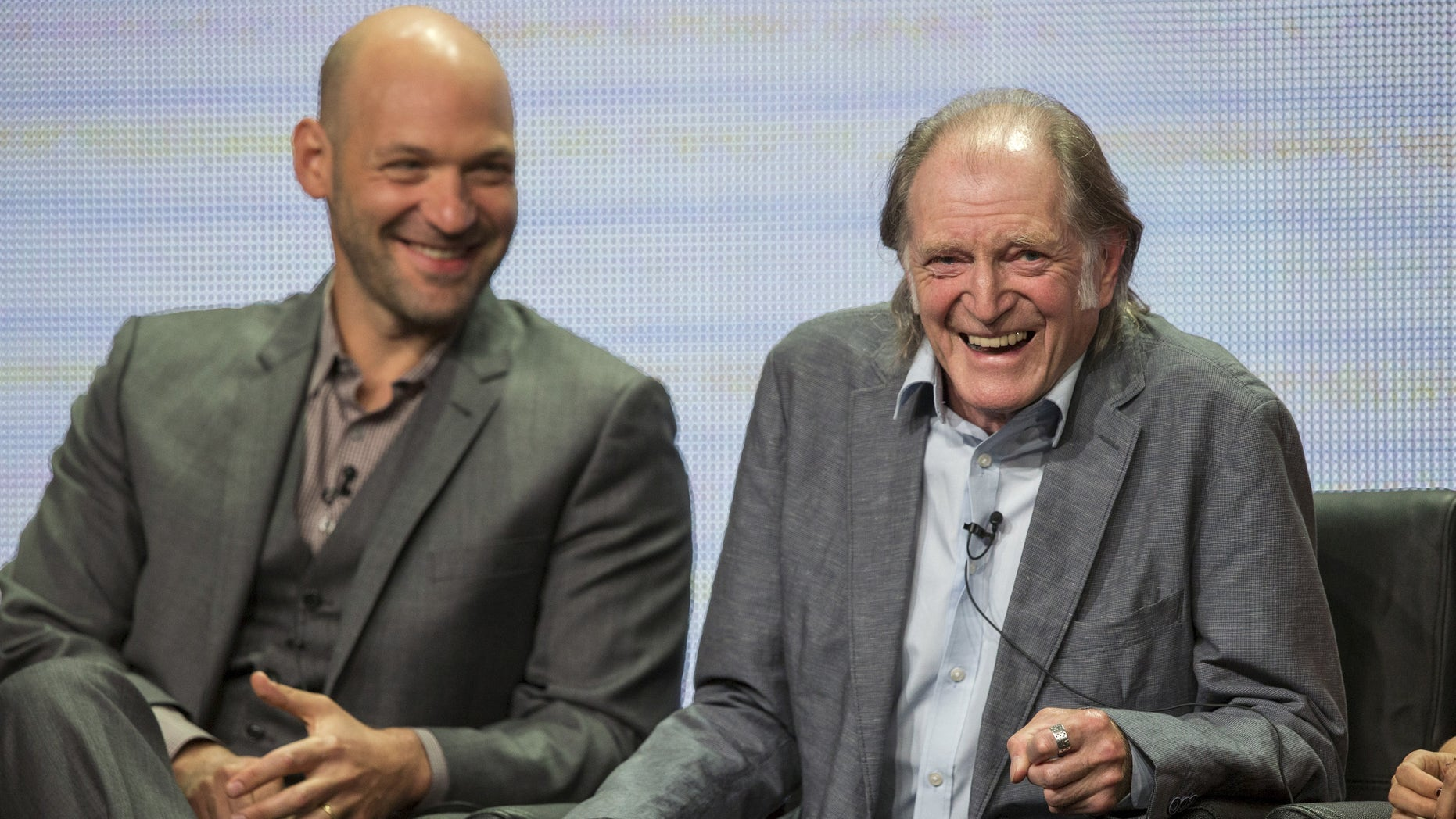 """Cast members David Bradley (R) and Corey Stoll laugh during a panel for the FX Networks television series """"The Strain"""" during the Television Critics Association Cable Summer Press Tour in Beverly Hills, California August 7, 2015. REUTERS/Mario Anzuoni - RTX1NJ7Z"""