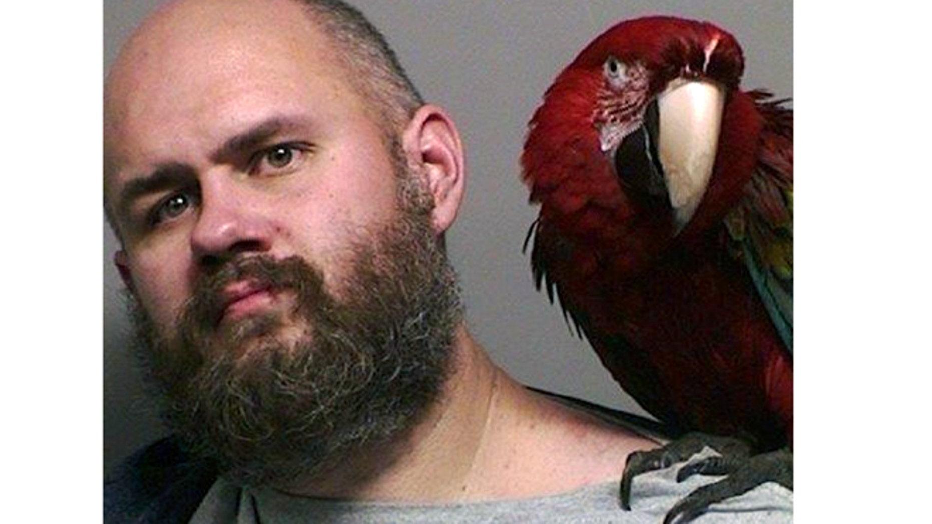 "Mug shot for Craig Buckner and his macaw, ""Bird."""