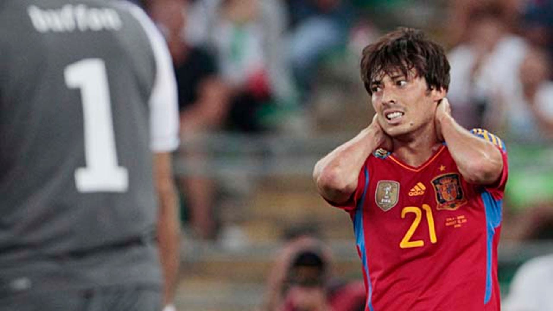 Spain's David Silva reacts after missing a scoring chance during a friendly soccer match against Italy in Bari, Italy, Wednesday, Aug. 10, 2011. Italy won 2-1. (AP Photo/Gregorio Borgia)