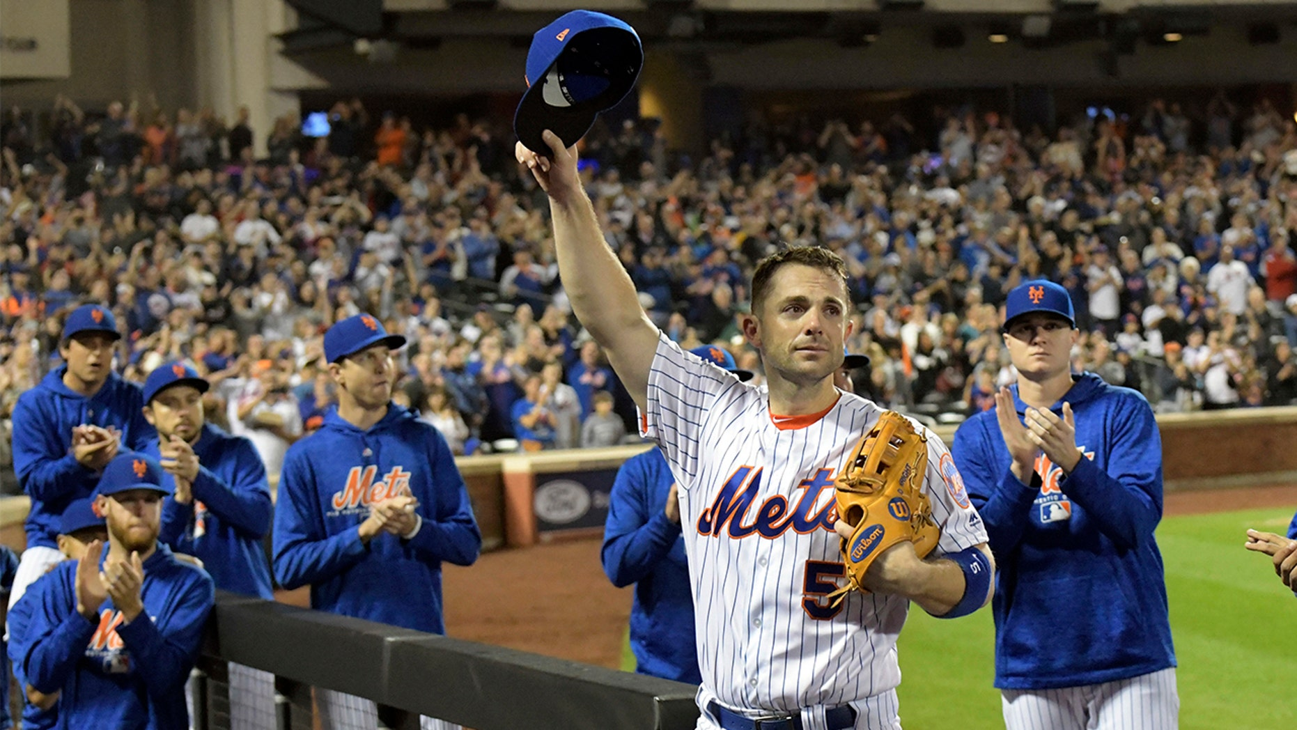 David Wright acknowledges the fans as he leaves the field after coming out of a baseball game during the fifth inning against the Miami Marlins, Saturday, Sept. 29, 2018, in New York.