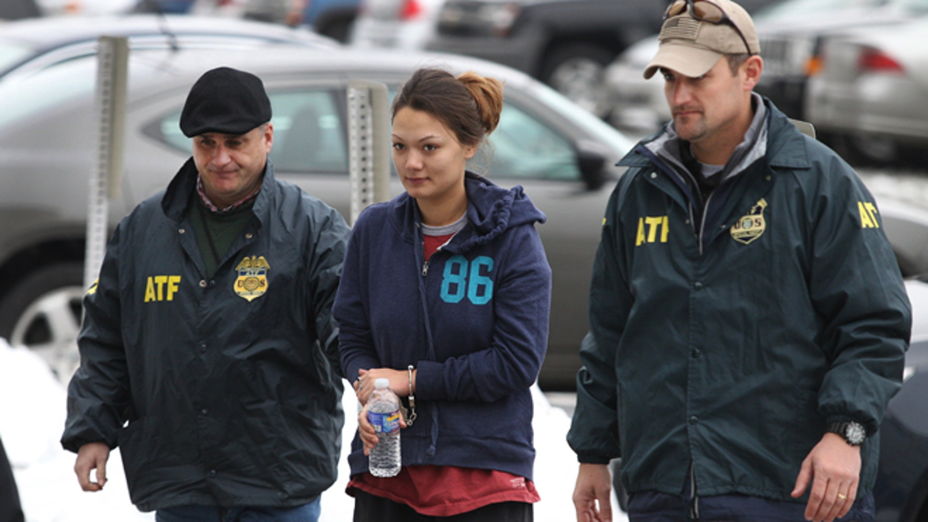 Dec. 28, 2012: Dawn Nguyen is escorted into the Federal Building in Rochester, N.Y., and charged in connection with the guns used in the Christmas Eve ambush slaying of two volunteer firefighters responding to a house fire in Webster, N.Y.
