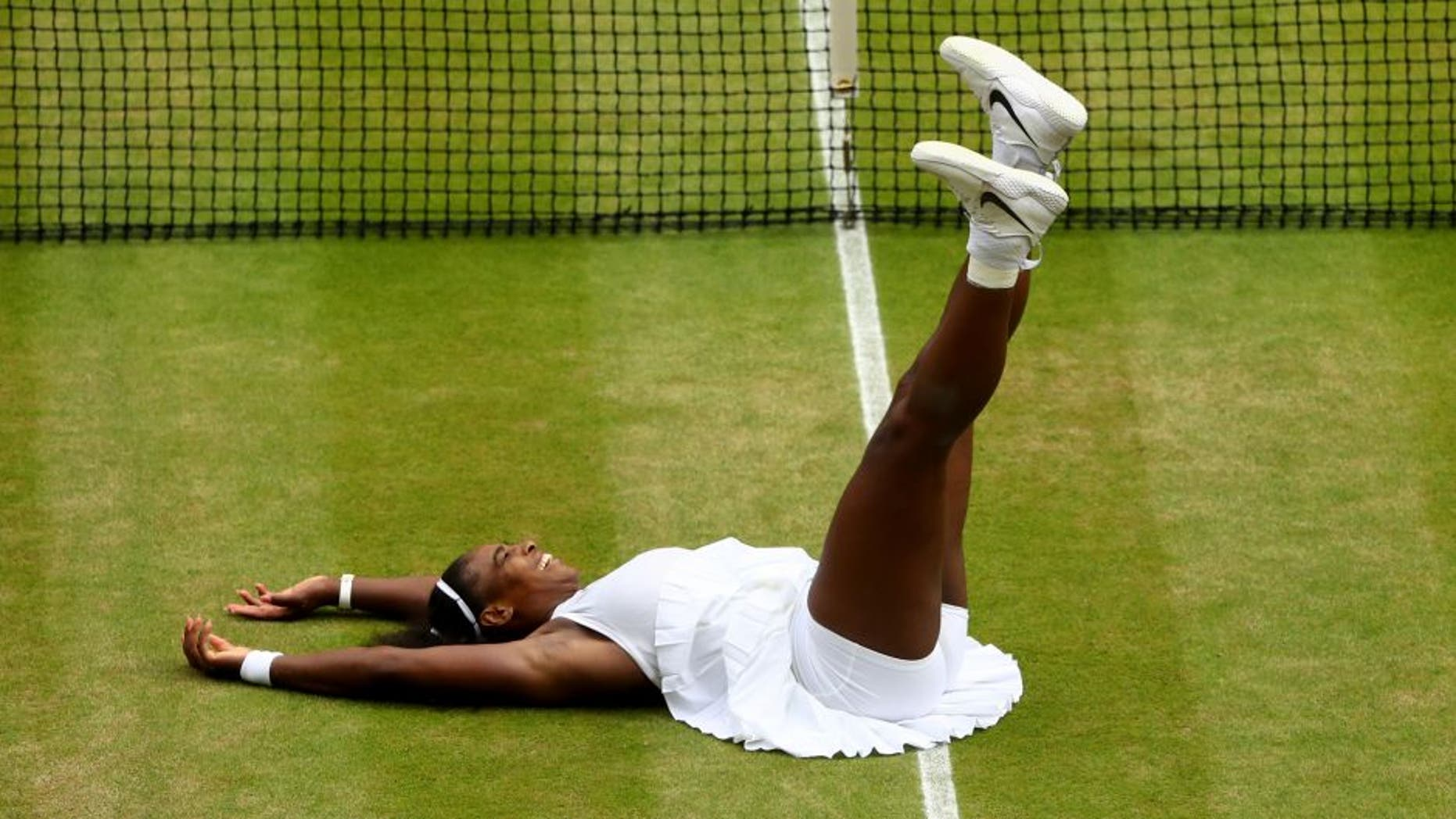 LONDON, ENGLAND - JULY 09: Serena Williams of The United States celebrates victory following The Ladies Singles Final against Angelique Kerber of Germany on day twelve of the Wimbledon Lawn Tennis Championships at the All England Lawn Tennis and Croquet Club on July 9, 2016 in London, England. (Photo by Julian Finney/Getty Images)