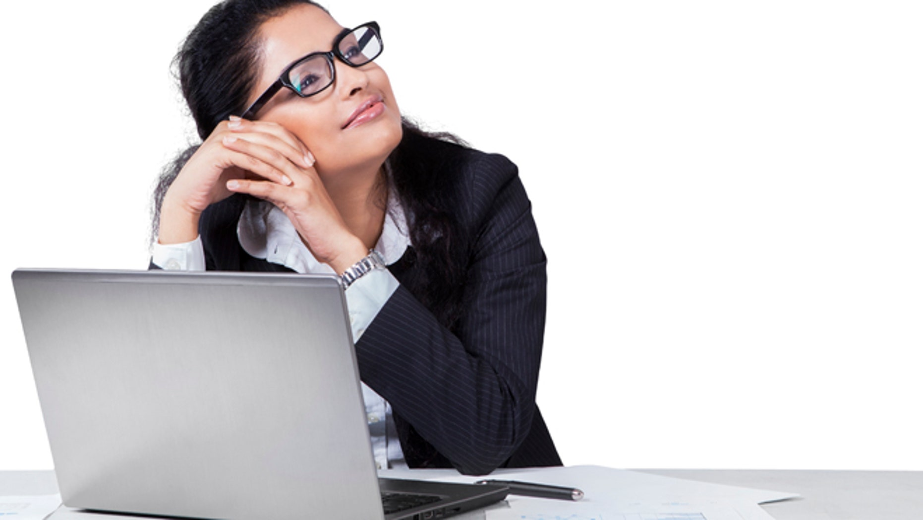 Portait of female entrepreneur working on desk while daydreaming, isolated on white background