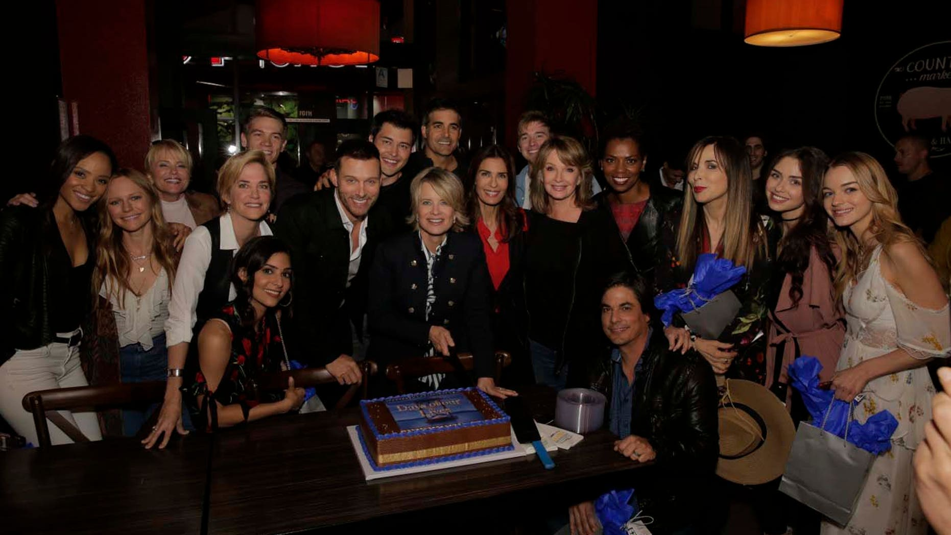 """The cast poses at the """"A Day of Days"""" event."""