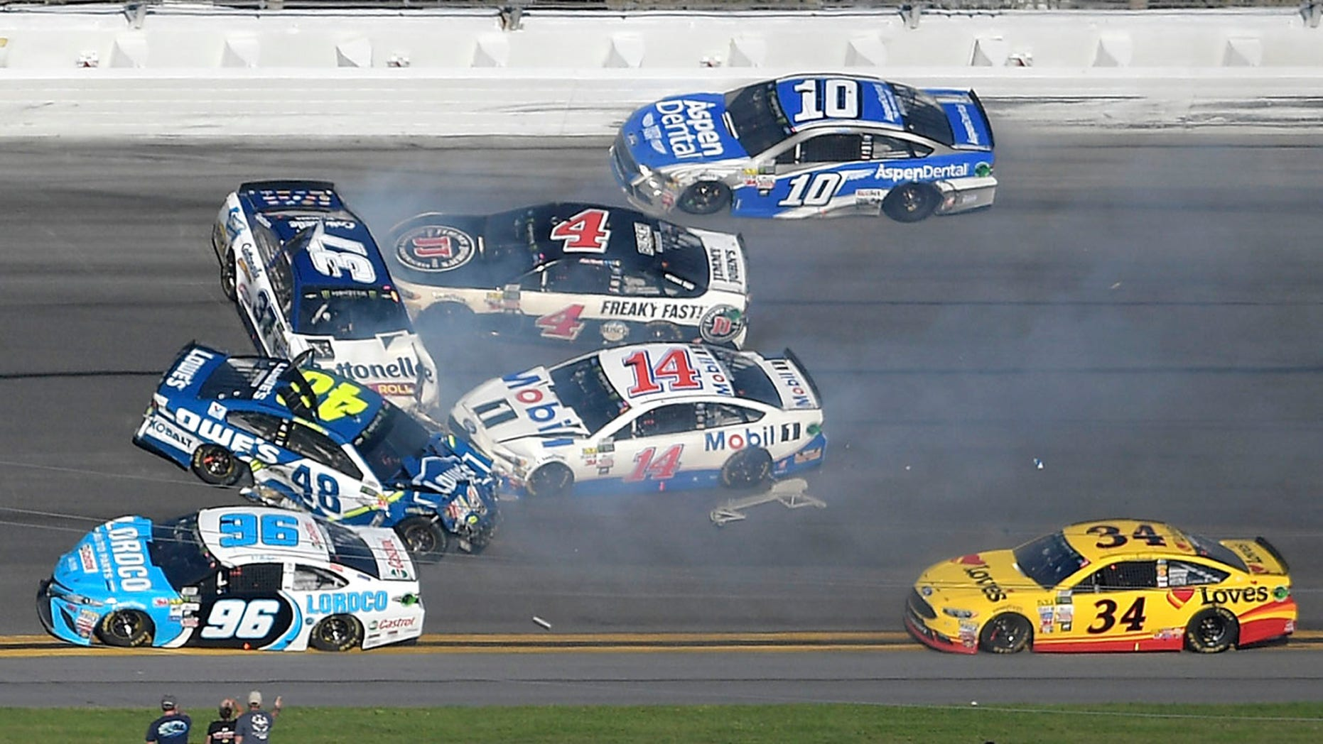 Feb. 26, 2017: Jimmie Johnson (48), Clint Bowyer (14), Chris Buescher (37), Kevin Harvick (4), D.J. Kennington (96) and Danica Patrick (10) collide in a multi-car wreck between Turns 3 and 4, as Landon Cassill (34) drives past.