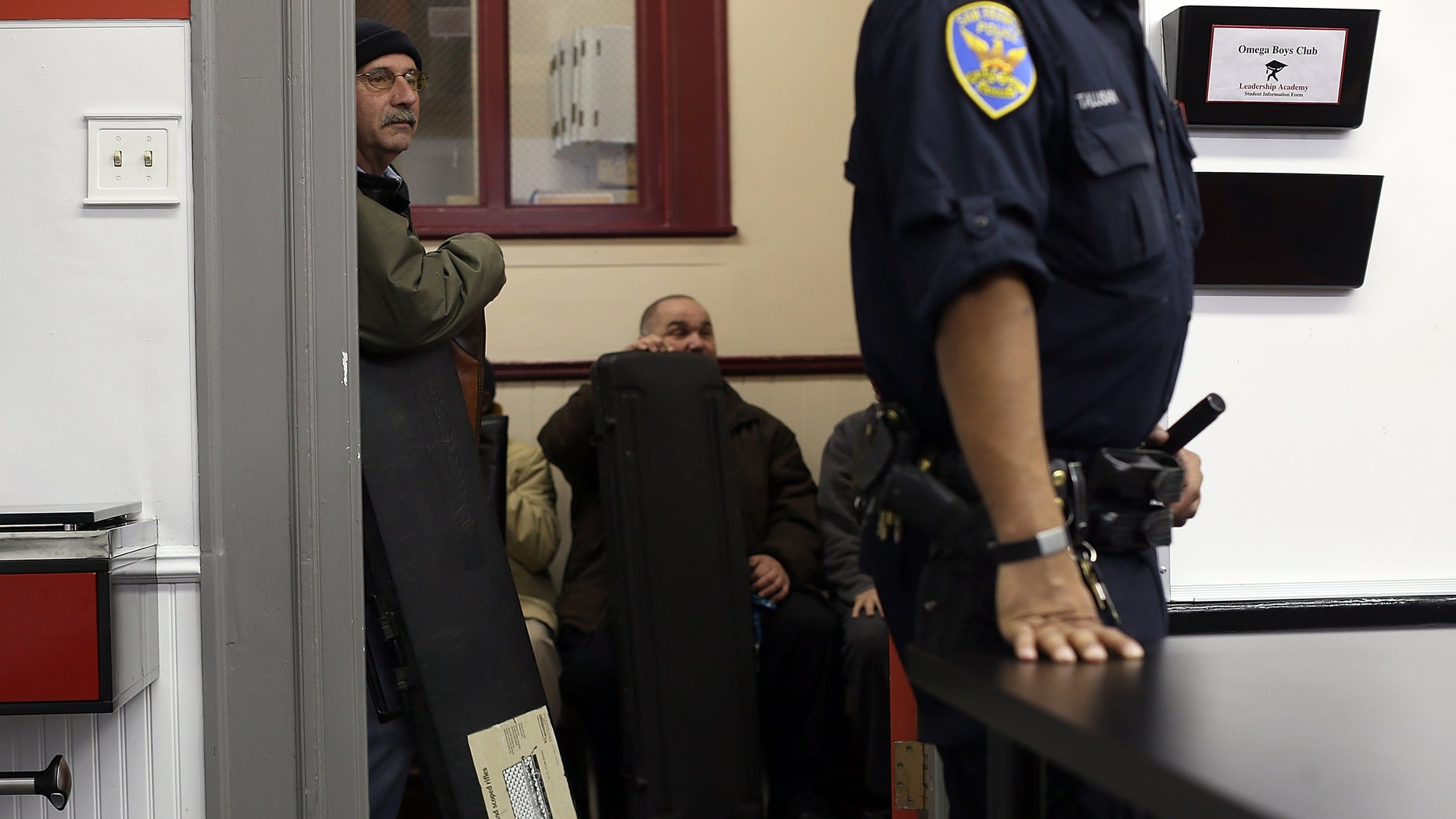 SAN FRANCISCO, CA - DECEMBER 15:  People wait in line to turn in firearms  during a gun buy back program on December 15, 2012 in San Francisco, California.  The San Francisco police department held a one-day gun buy back event that paid $200 per gun turned in. A better than expected crowd resulted in payback money running out and vouchers were issued to collect money within a week. Over 200 guns were collected.  (Photo by Justin Sullivan/Getty Images)