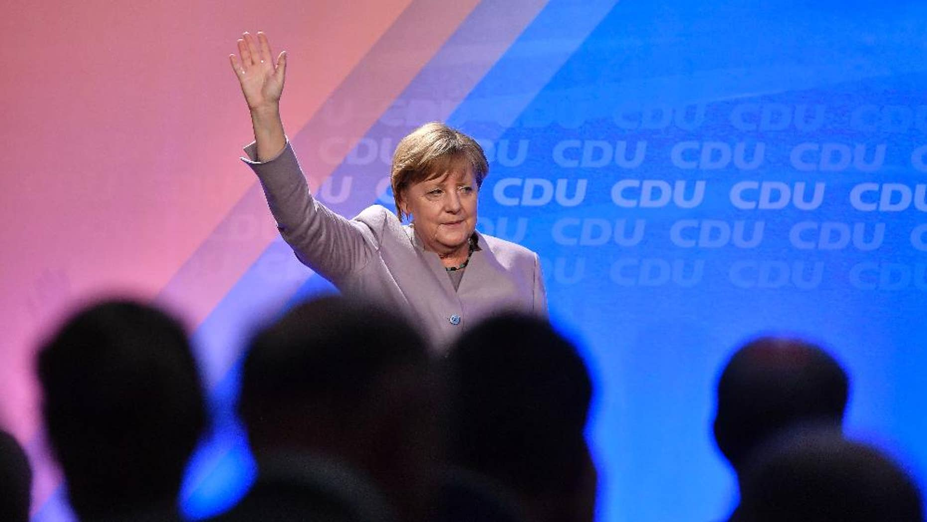 German chancellor Angela Merkel waves to supporters during an election campaign in Oelde, Germany, for the upcoming state elections in North Rhine-Westphalia, Thursday, April 27, 2017. Germany's most populated province elects a new parliament on May 14. (AP Photo/Martin Meissner)