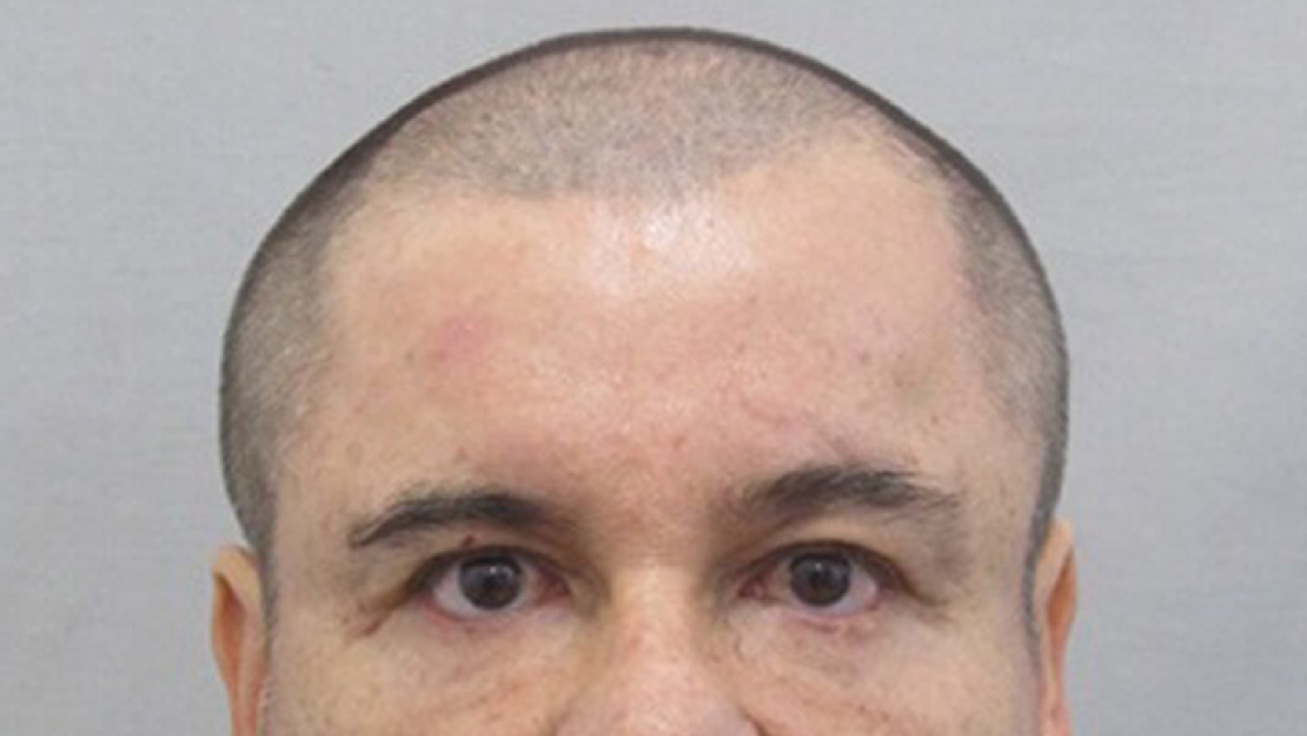 """This photo provided by Mexico's attorney general, shows the most recent image of drug lord Joaquin """"El Chapo"""" Guzman before he escaped from the Altiplano maximum security prison in Almoloya, west of Mexico City, Sunday, July 12, 2015. The Mexican government is offering a 60 million pesos (about $4 million dollars) reward for information leading to his capture, after Guzman, escaped from the maximum security prison through a mile long tunnel that opened into the shower area of his cell. (Mexico's Attorney General's Office via AP)"""