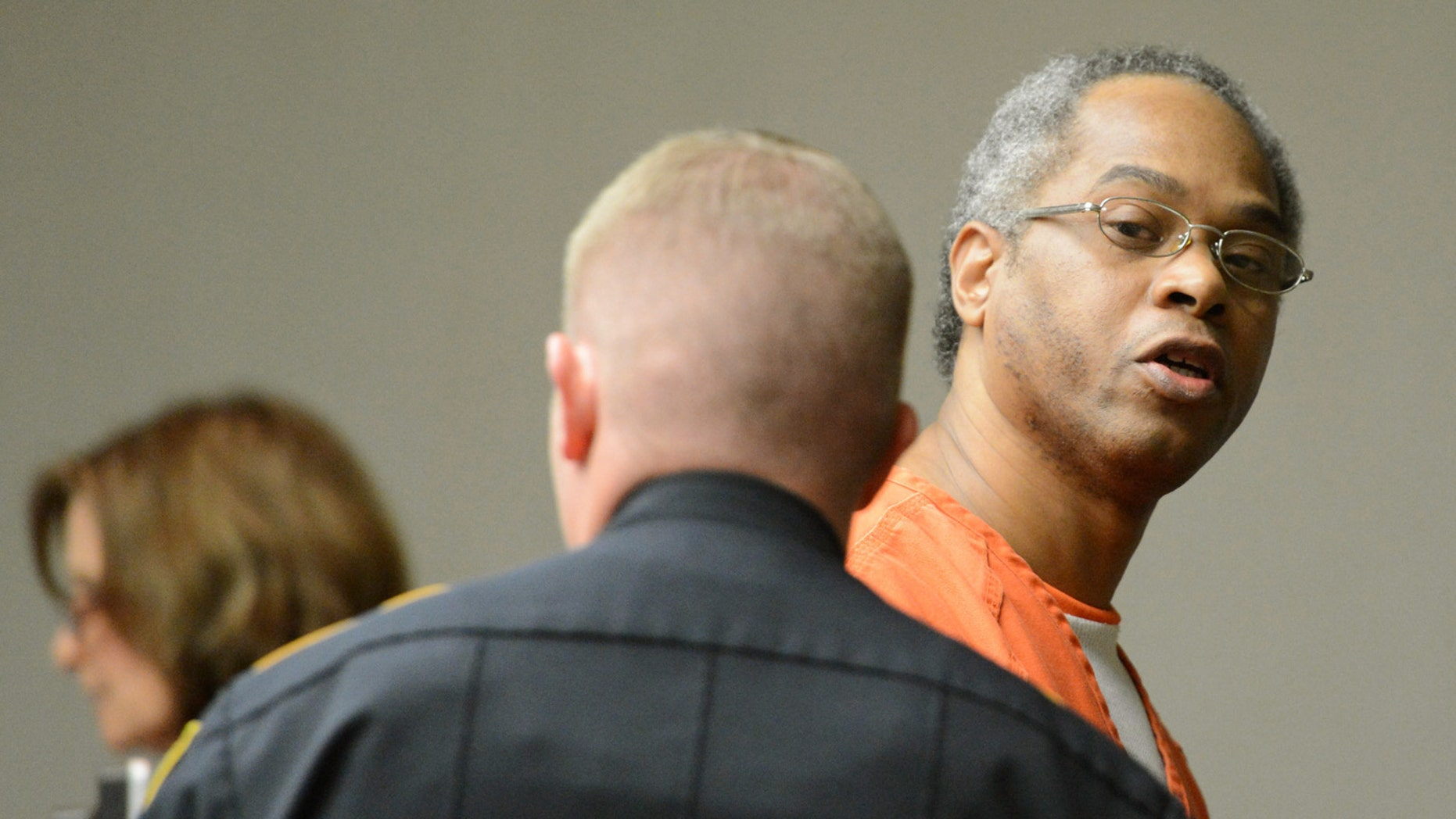 In this Nov. 15, 2012 photo, Carl Henry Blue looks back at family and friends while being escorted back to jail after having his execution date set at the Brazos County Courthouse in Bryan, Texas.  Blue never disputed filling a convenience store drink cup with gasoline, tossing it on his former girlfriend at the door of her apartment and setting her ablaze.  Nineteen days after the September 1994 incident, 38-year-old Carmen Richards-Sanders died of her burns.  Now, more than 18 years later, Blue, 48, is set to die Thursday, Feb. 21, 2013,  evening for what he contended was a prank gone bad and for what prosecutors successfully argued was capital murder.  Blue's execution would be the first this year in Texas, the nation's most active death penalty state. Fifteen inmates were executed last year. Blue is among at least 12 Texas prisoners scheduled for lethal injection in the coming months.   (AP Photo/Bryan-College Station Eagle, Dave McDerman)