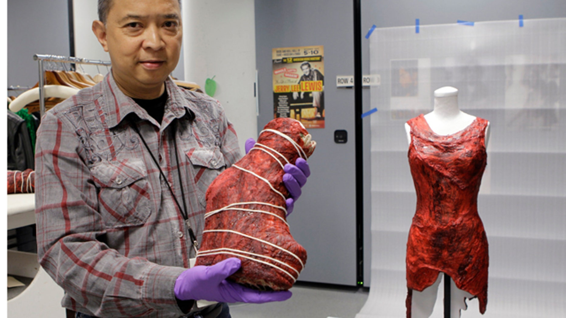June 14: Jun Francisco, director of collections management at the Rock and Roll Hall of Fame and Museum, displays a boot and dress made of meat worn by Lady Gaga in the museum's vault.