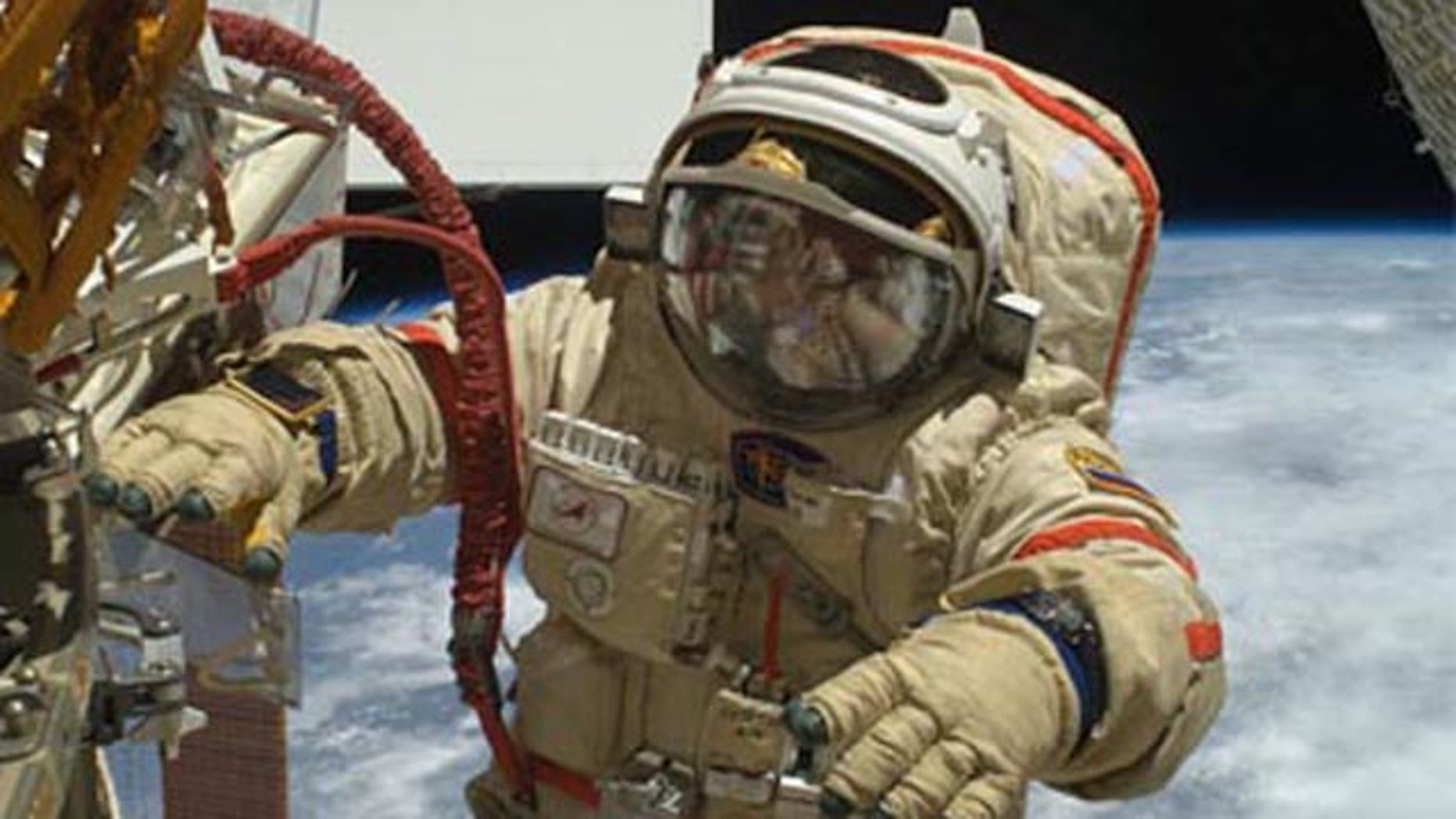 Two Russian cosmonauts on Tuesday completed a nearly 7-hour-long spacewalk to replace a video camera and improve cable connections to the orbiting laboratory's newest module.