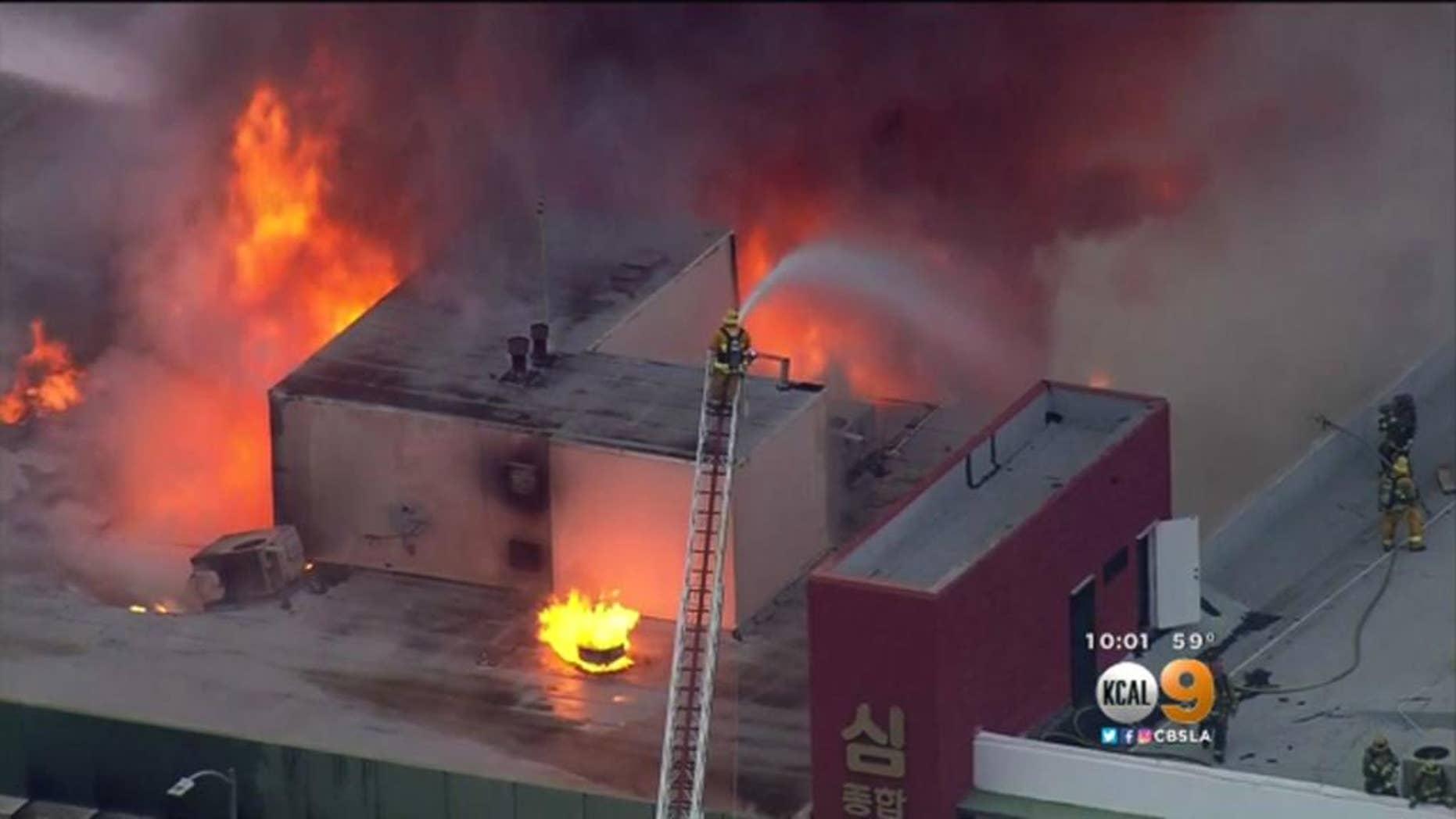 Firefighters battling the blaze on Monday.