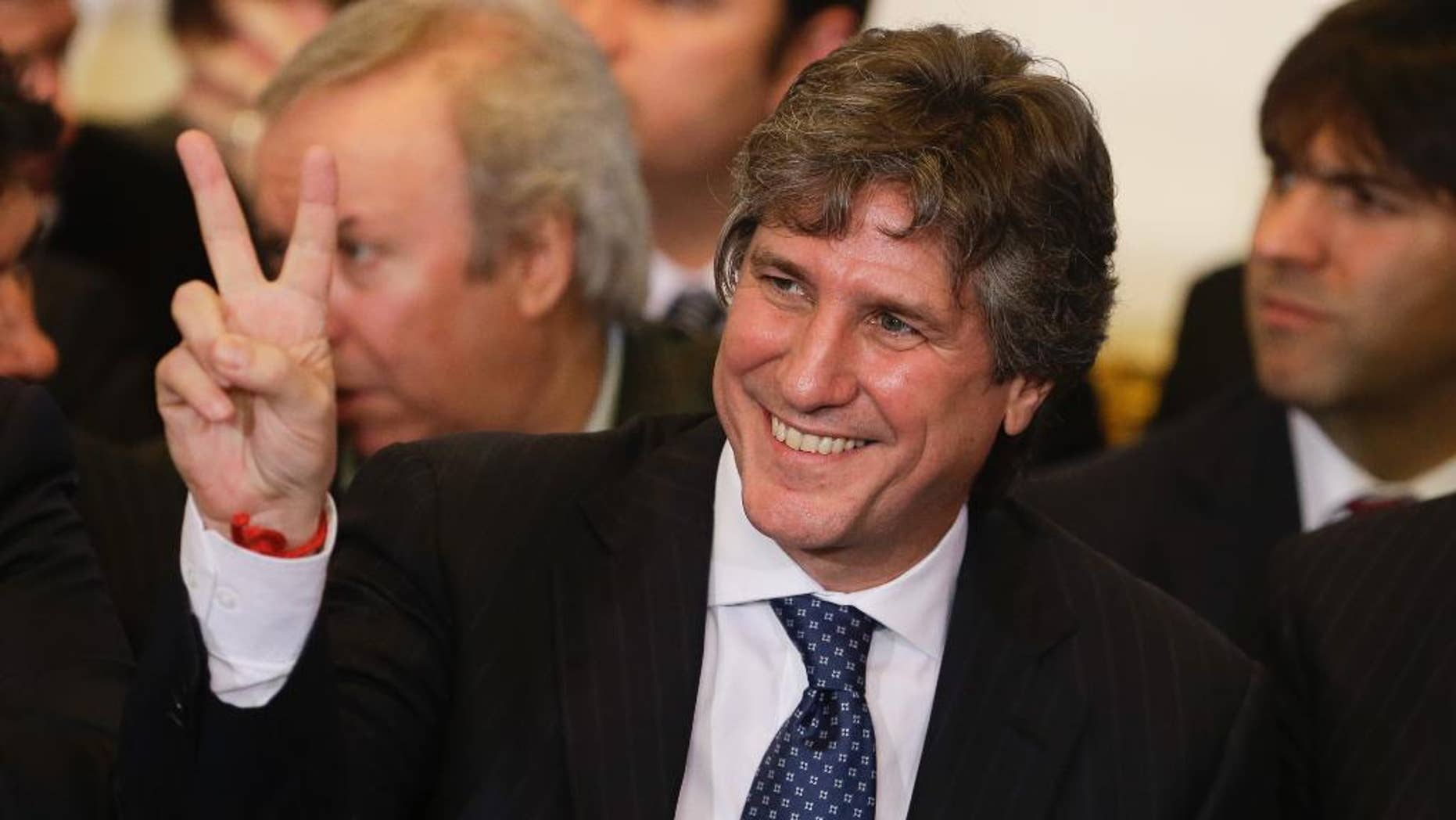 FILE- In this  July 31, 2014, file photo, Argentina's Vice President Amado Boudou gestures to supporters before the speech of Argentine President Cristina Fernandez at Casa Rosada Presidential Palace in Buenos Aires, Argentina. Argentina's highest tribunal confirmed on Thursday, June 25, 2015, bribery charges against Boudou. If found guilty, the vice president could face prison and be barred for life from public office. (AP Photo/Victor R. Caivano, File)