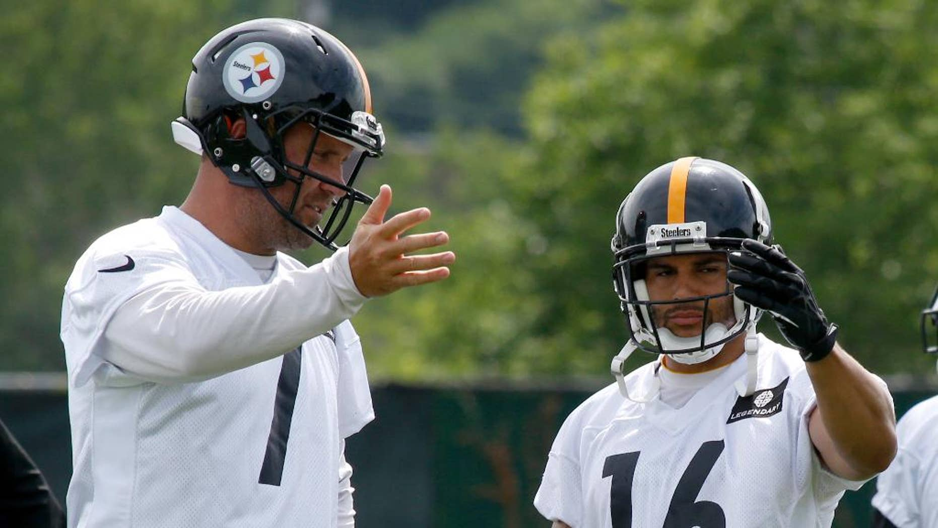 Pittsburgh Steelers quarterback Ben Roethlisberger (7) and wide receiver Lance Moore (16) talk about pass routes during an NFL football organized team activity on Wednesday, June 11, 2014 in Pittsburgh. (AP Photo/Keith Srakocic)