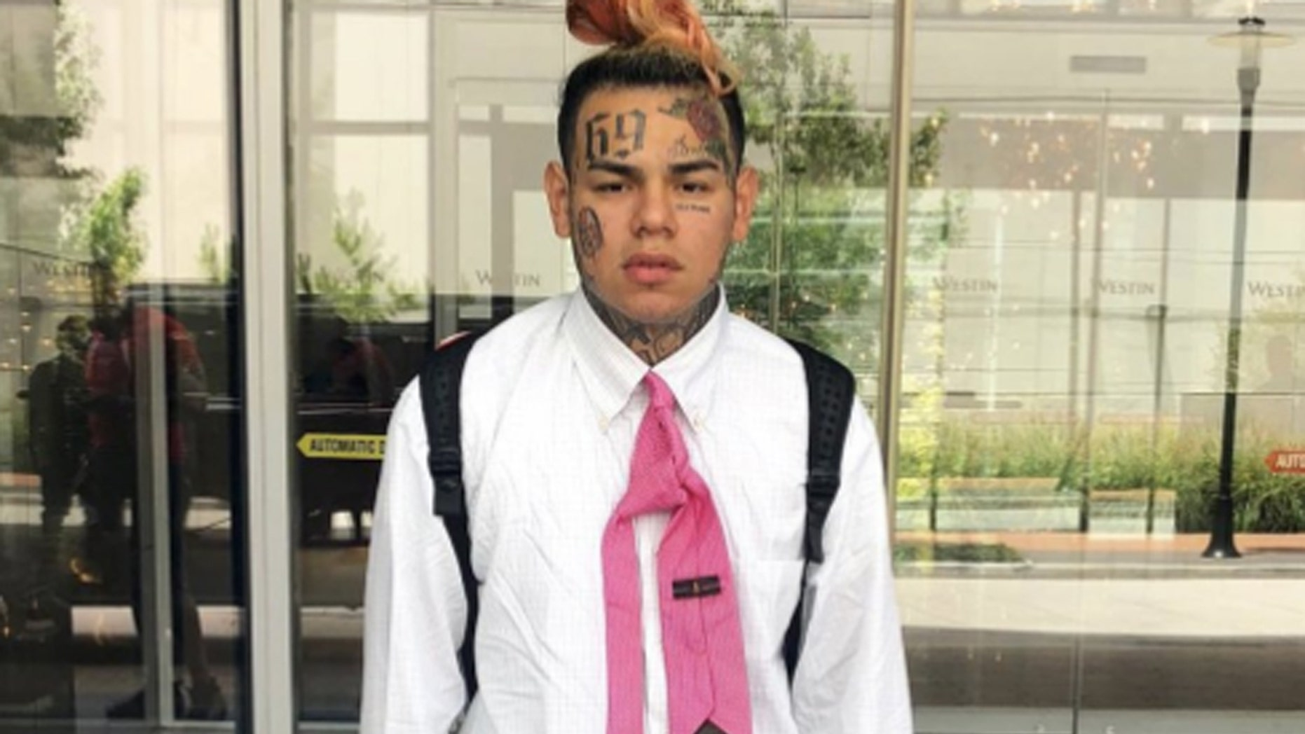 Tekashi 6ix9ine was hanging out at an infamous Queens strip club before he got held up this weekend, The New York Post reported.