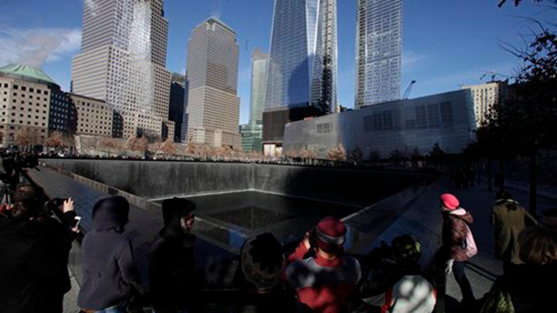 December 29, 2011: Visitors walk around the National September 11 Memorial.