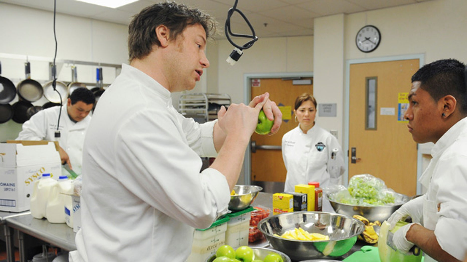 """This undated photo courtesy of ABC shows celebrity chef Jamie Oliver during a scene filmed in Los Angeles from the second season of """"Jamie Oliver's Food Revolution,"""" on the ABC Television Network. The second season of """"Jamie Olivers Food Revolution,"""" which begins Tuesday, April 12, started poorly when the Los Angeles school district barred Oliver's cameras _ greatly complicating a show that focuses on school lunches.     (AP Photo/ABC, Mitch Haddad)"""