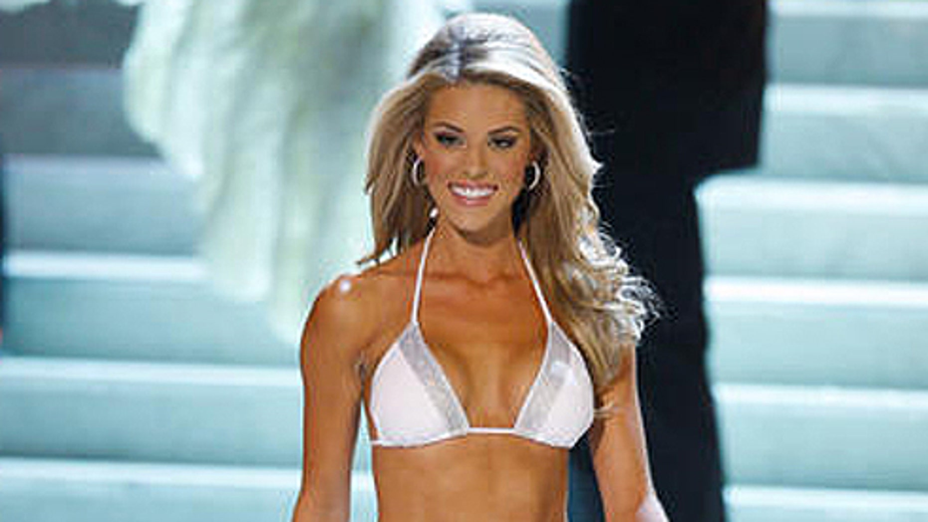 April 26, 2009: Then-Miss California Carrie Prejean participates in swimsuit portion of Miss USA pageant. (AP Photo/Denis Poroy)