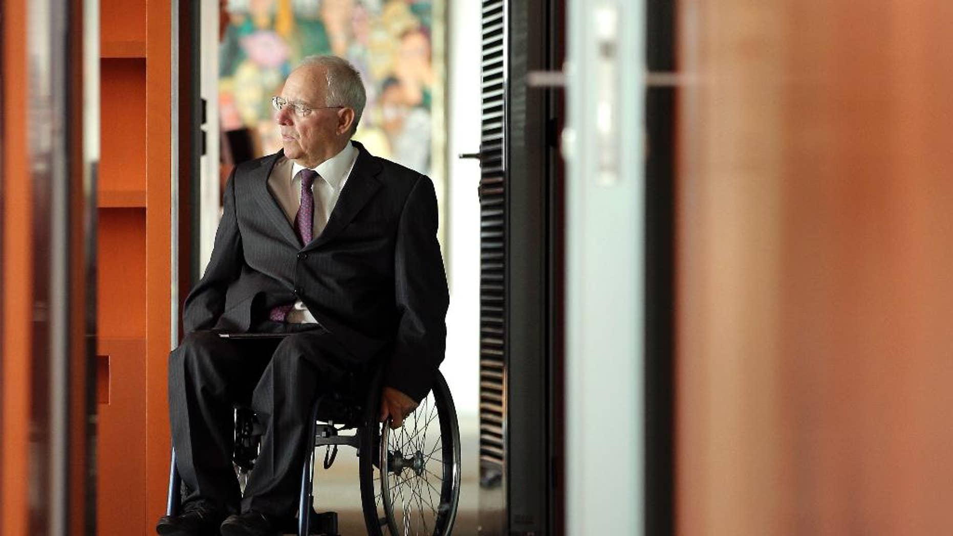 German Finance Minister Wolfgang Schaeuble arrives for the weekly cabinet meeting at the Chancellery in Berlin, Germany, Wednesday, May 18, 2016. (AP Photo/Michael Sohn)