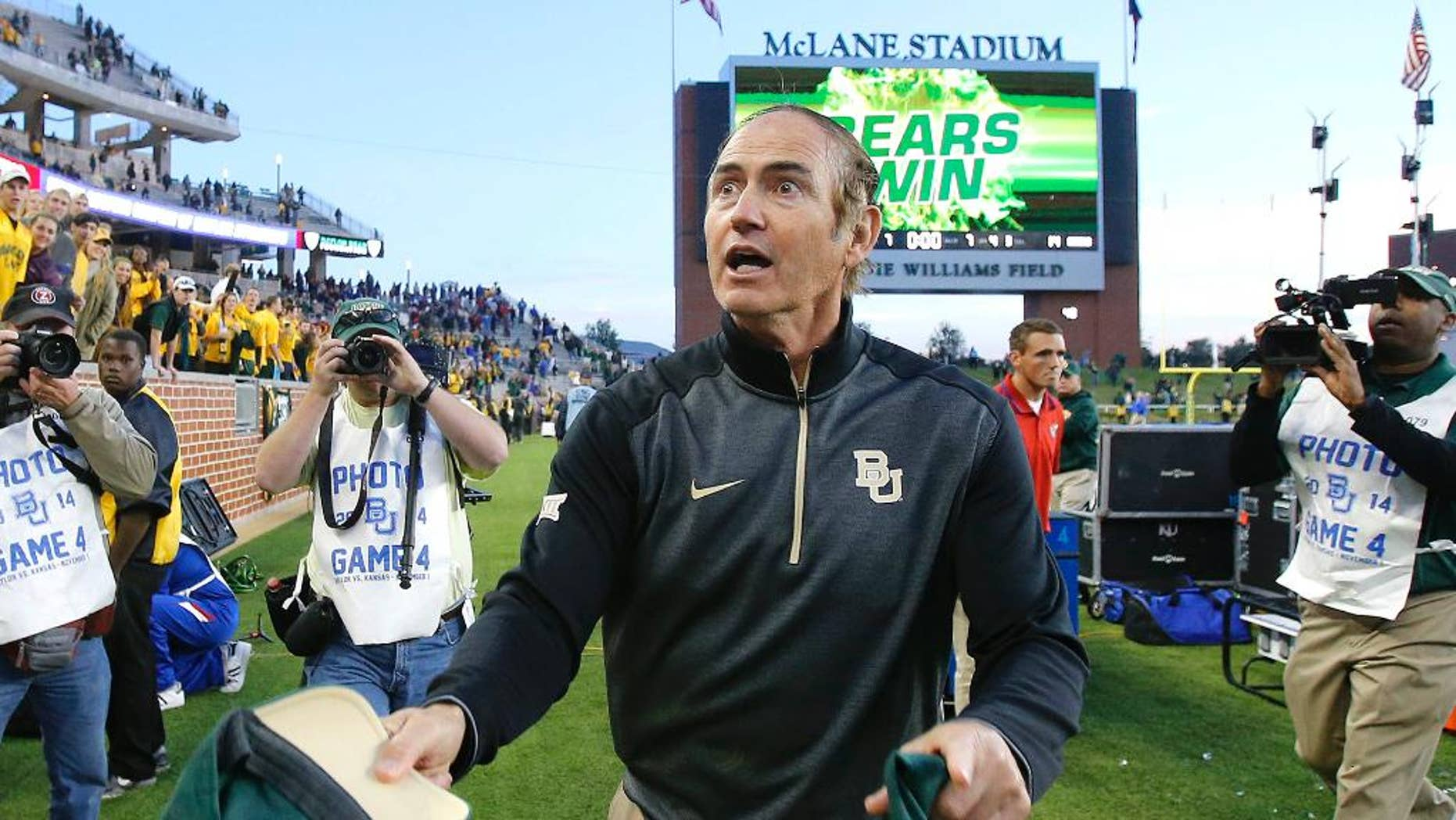 Baylor head coach Art Briles head toward the student section to toss them a autographed game winning cap after defeating Kansas 60-14 in a NCAA college football game, Saturday, Nov. 1, 2014, in Waco, Texas. (AP Photo/ Jerry Larson)